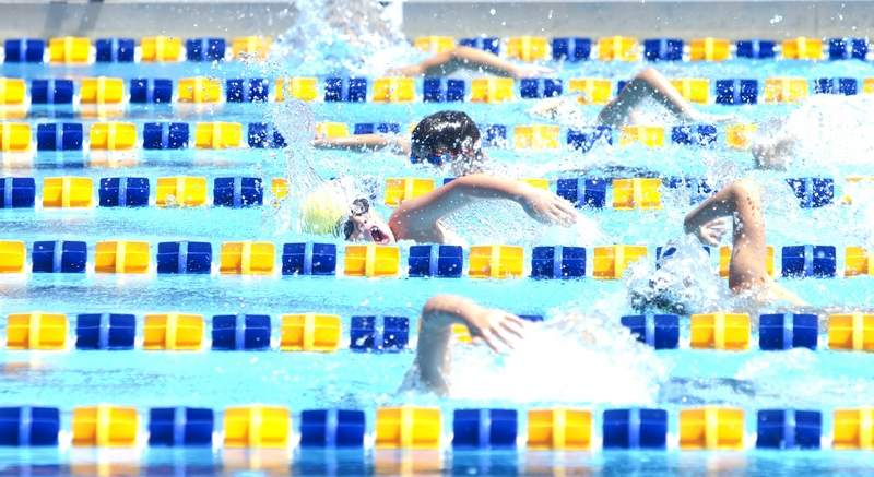 Marion's Max Motsinger swims the opening leg of a relay race during the Southern Illinois Swim League Championships hosted by the Marion Marlins on Saturday.