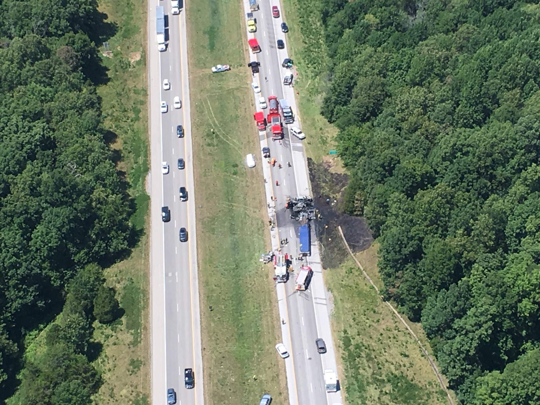 This aerial photo shows the aftermath of an eight-vehicle accident on Interstate 24 near the I-57 split in Johnson County. Three of the vehicles caught fire, with flames spreading to a nearby treeline before being extinguished by the Lake of Egypt Fire Department.