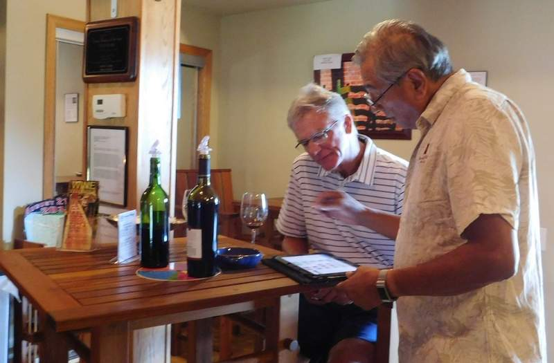 David Ponce takes a rare opportunity to enjoy a taste of his own product as he discusses his wines with visitors to the tasting room Saturday. Ponce and his wife, Beth, opened the tasting room in 2009.