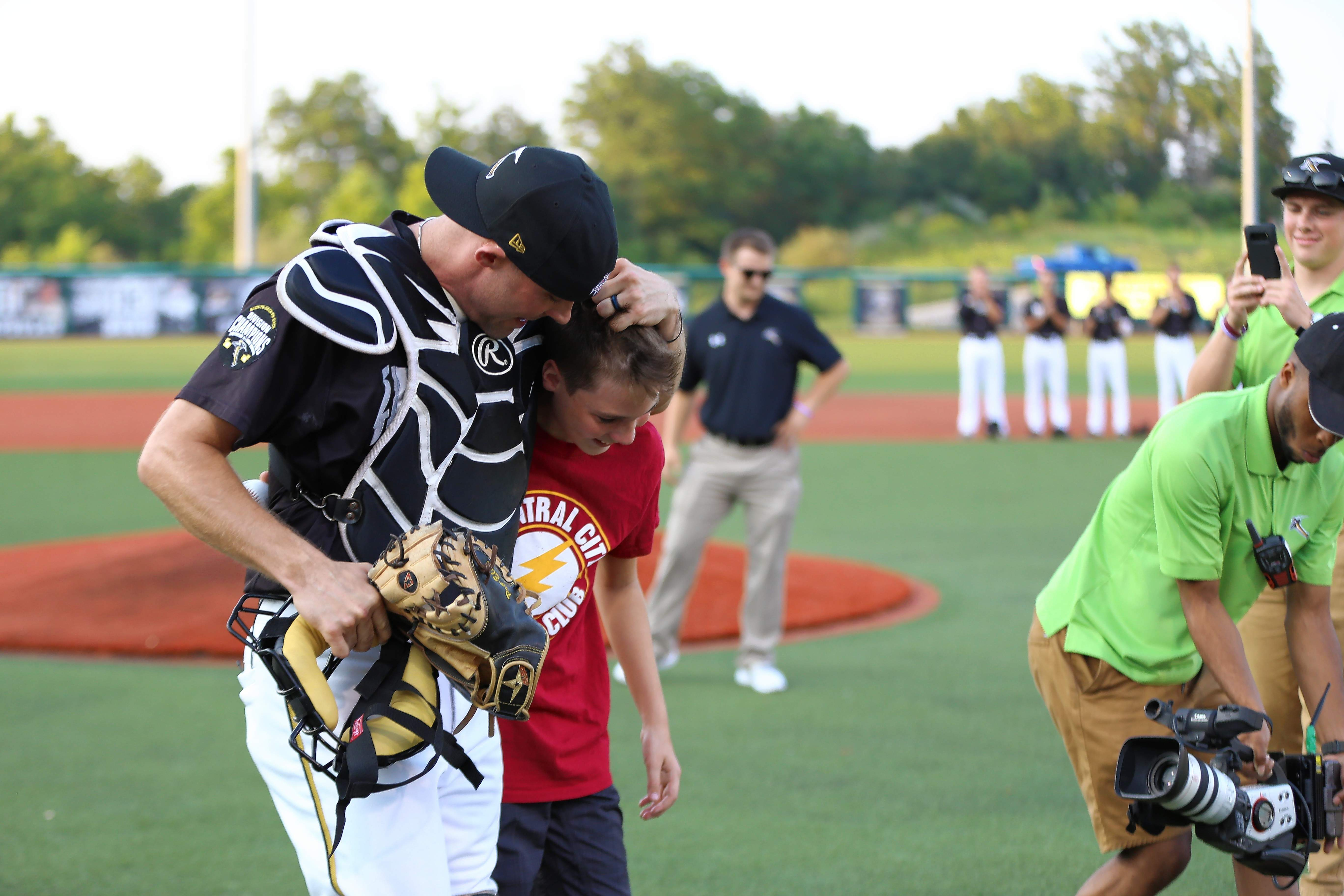 Kenny and Logan Hatton of Harrisburg walk off the field at Miners Stadium Wednesday night after their surprise reunion.