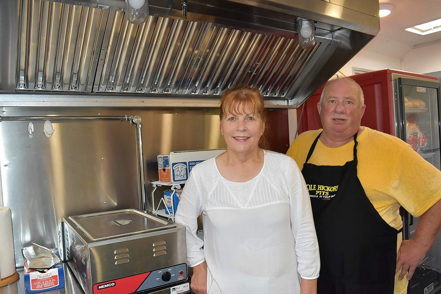 Peggy and Mickey Woolard take a break from setting up their barbecue truck.