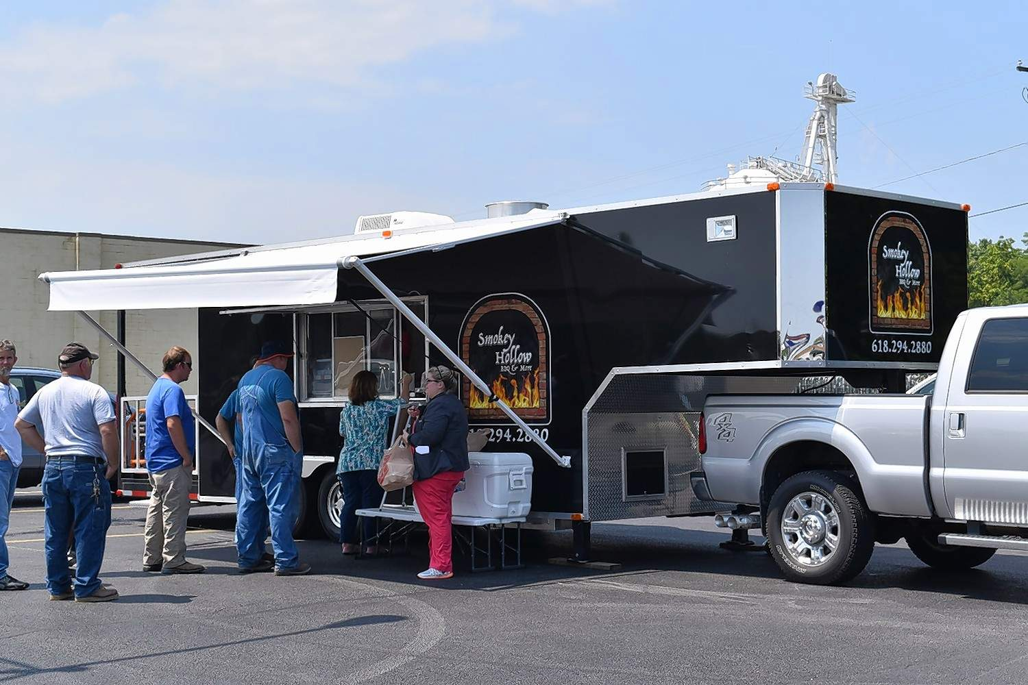 The Woolards' barbecue truck has featured a steady stream of customers since this first day of selling barbecue in the parking lot of Parker Plaza.