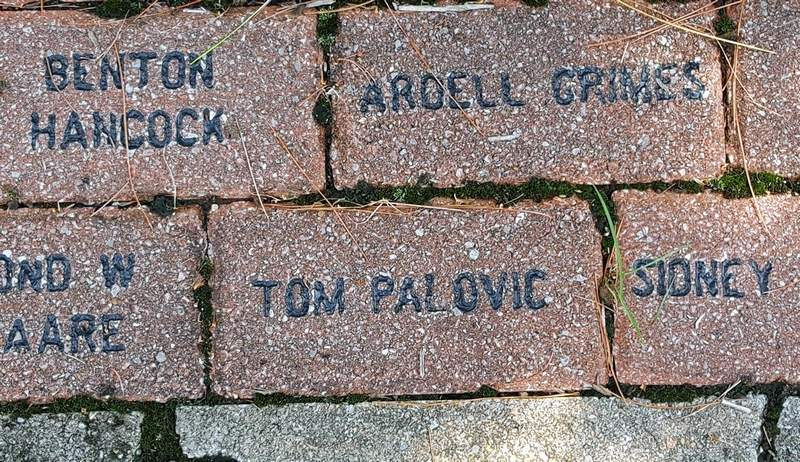 Tom Palovic's contributions to the CCC are honored with this inscribed brick, one of several dozen that accompany the statue and memorial located behind the Giant City Lodge.