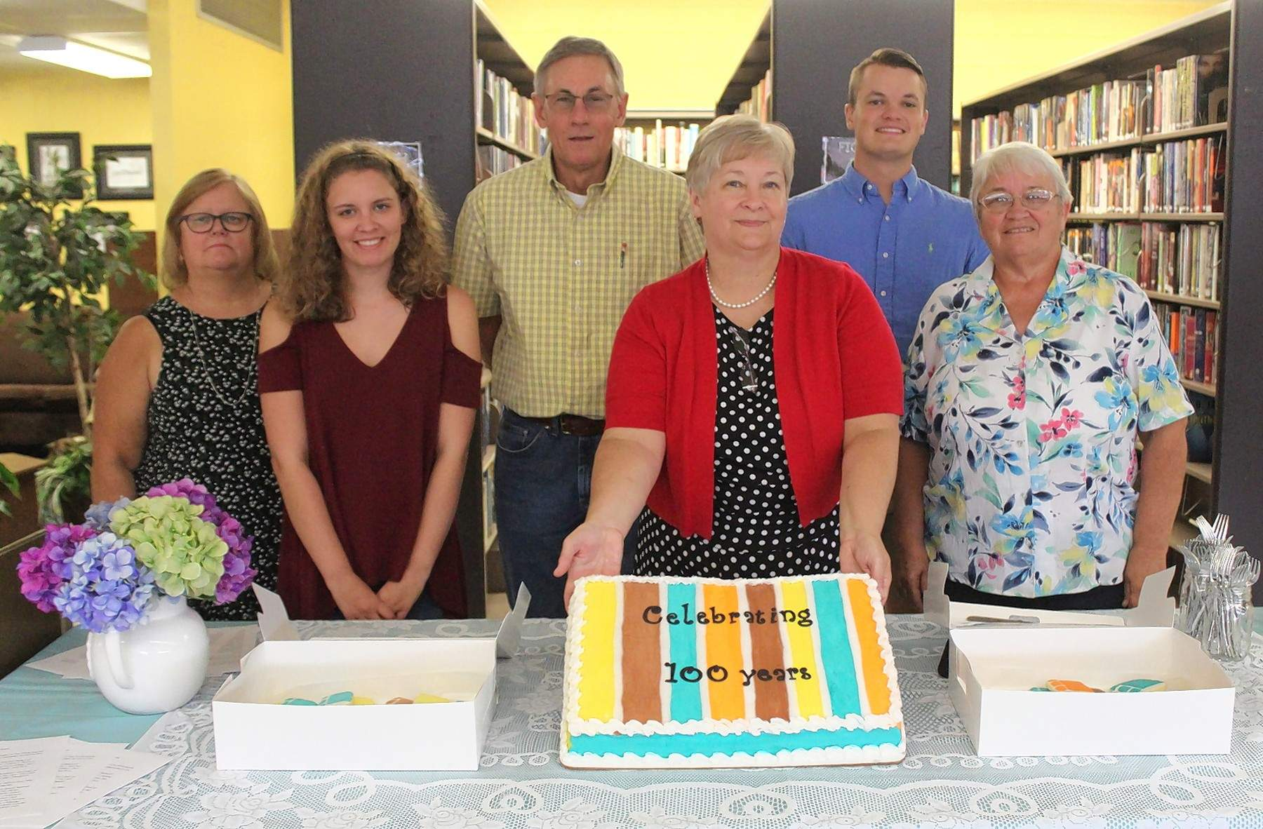 From left, library board member Connie Mathis, assistant Phoebe Issler, board member David Stone, Librarian Kathy West, assistant Lee Wittenauer and board member Charlene Butcher.