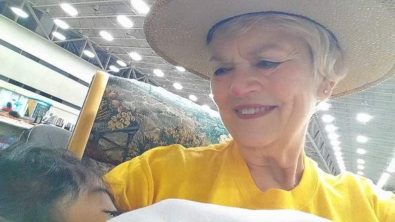 Jan Kragness of Johnston City rocks a child, one of more than 100 daily being cared for by a group from the Southern Baptist Disaster Relief team that is helping evacuees in a Dallas relocation center.