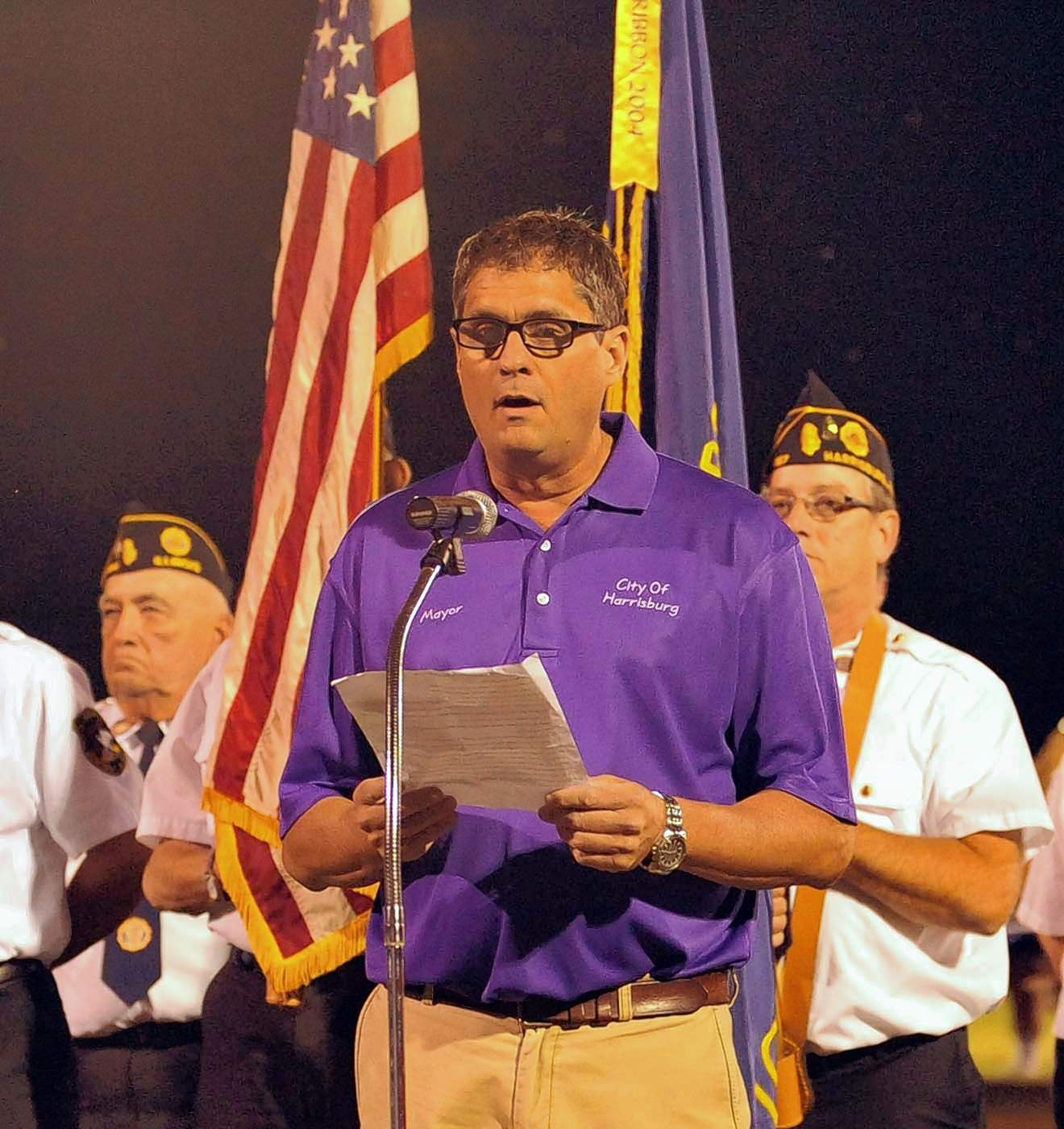 Harrrisburg Mayor John McPeek addresses the crowd at a 911 remembrance ceremony Friday at halftime of the football game.