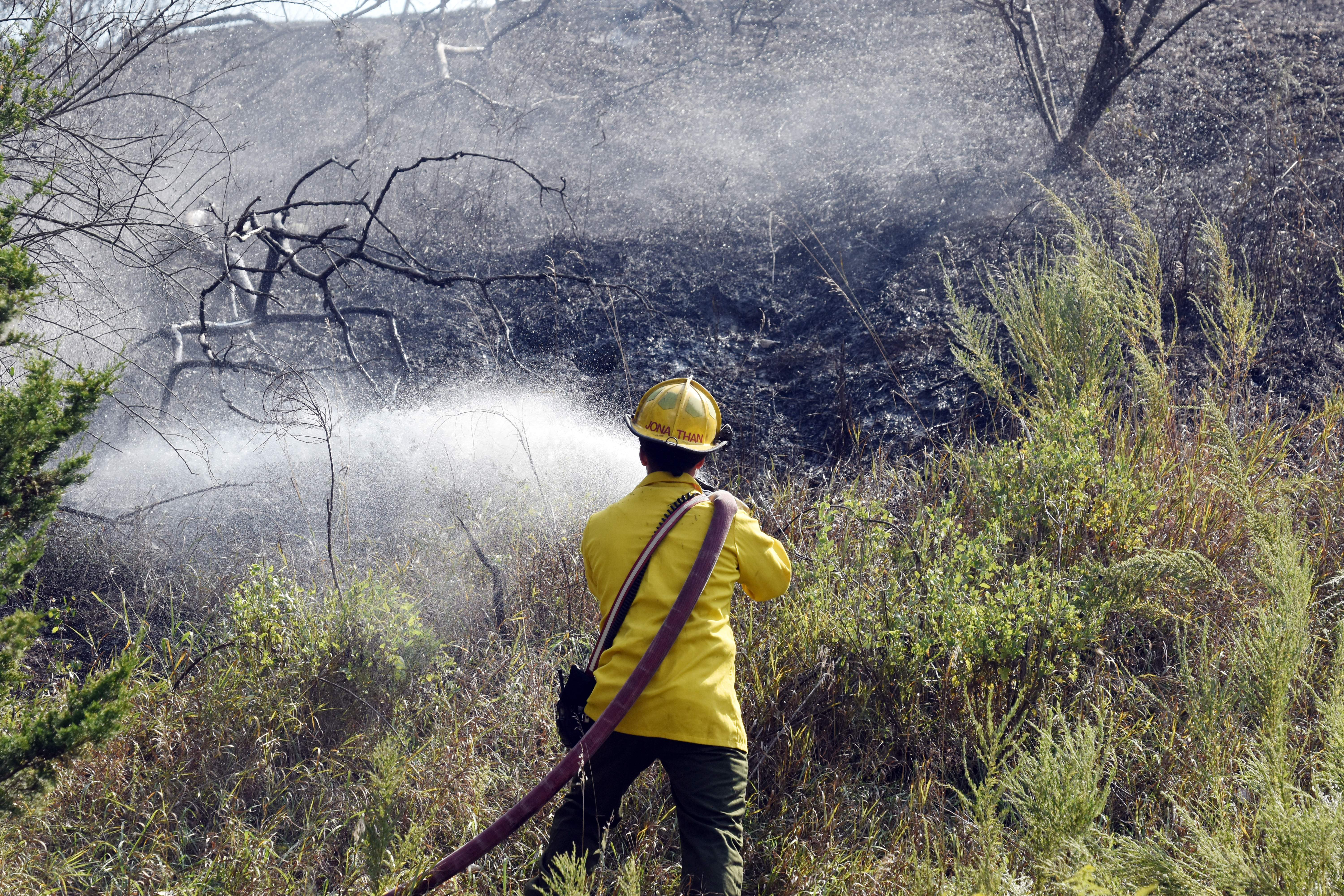 A firefighter works to extinguish a Sept. 16 brush fire in Percy near the rock pile off of Percy Road. Roughly 10 acres was burned. Both Steeleville and Percy firefighters responded to the call.