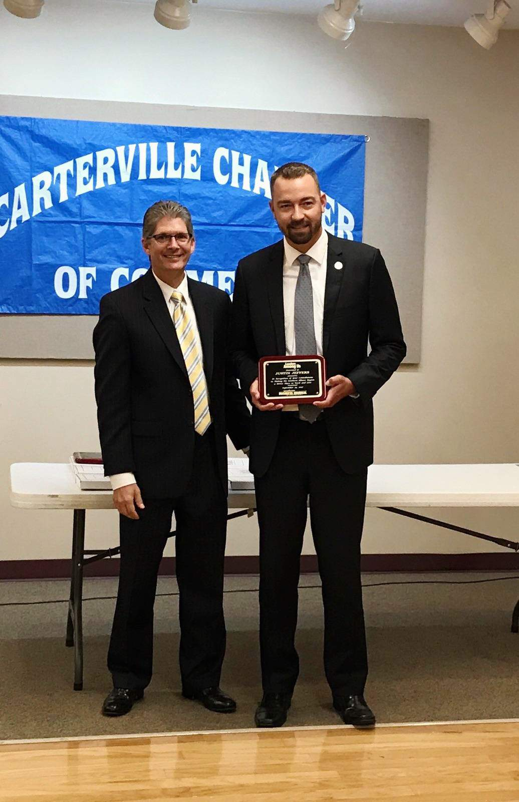 """Randolph County Treasurer Justin Jeffers (right) is pictured with The Southern Illinoisan publisher Craig Rogers during a """"Leaders Among Us"""" ceremony at the Carterville Community Center."""