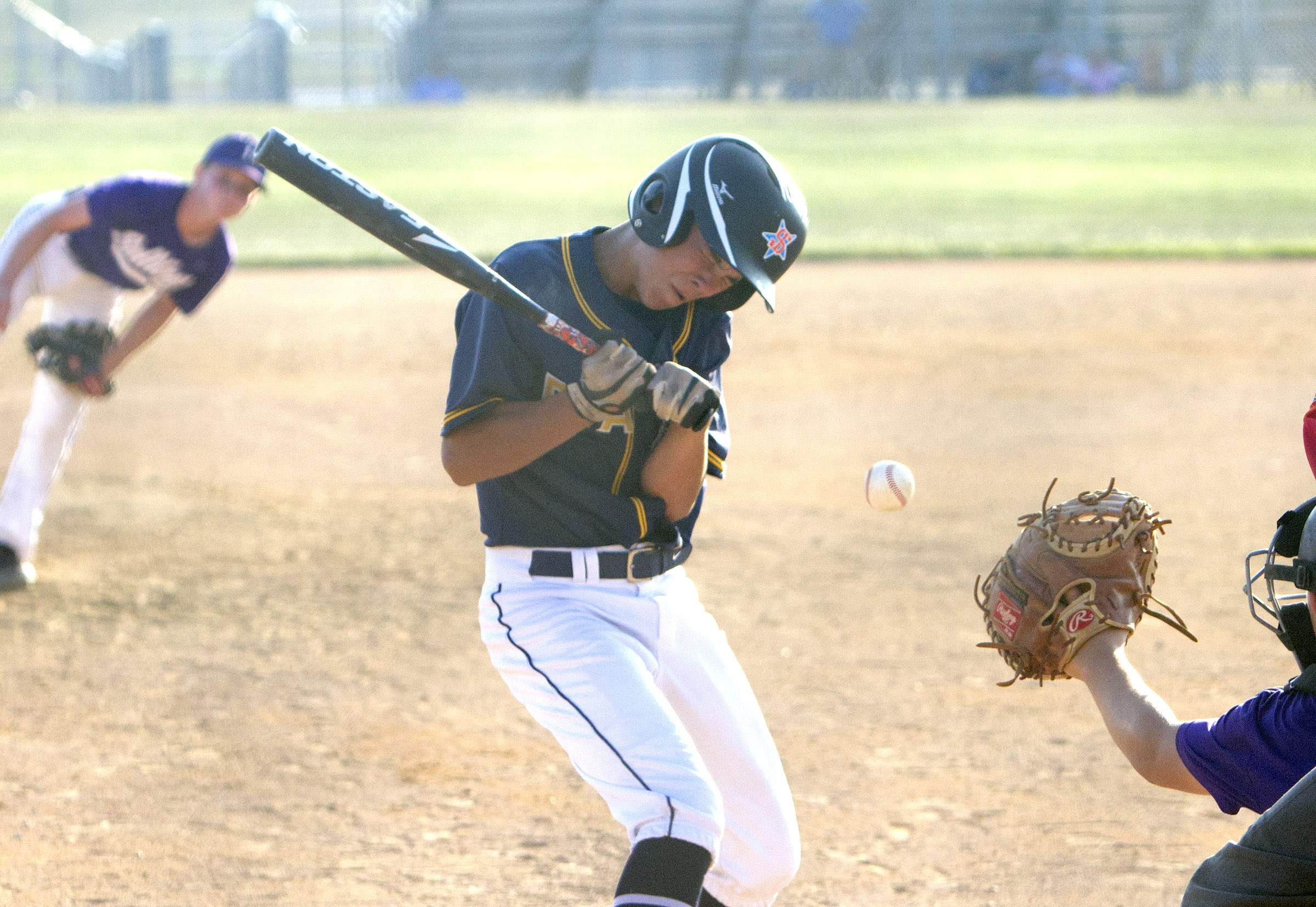 Trace Bittle pulls back from an inside pitch.