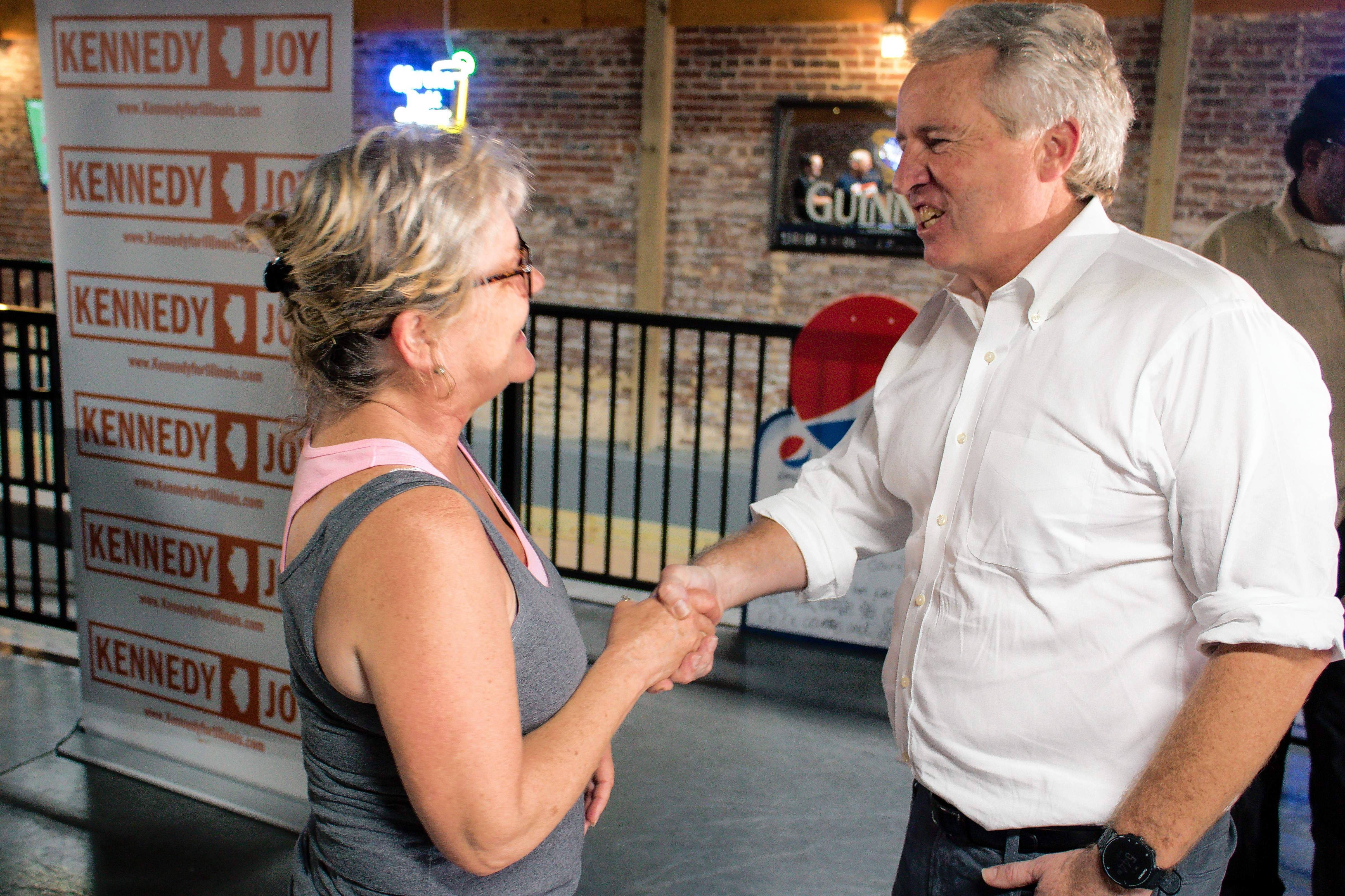 Kristin Moore photoChris Kennedy, candidate for Illinois governor, visits Pookie's Beer, Burgers, and Bocce in downtown Marion Saturday. Kennedy greeted everyone there, including Susan Pierce of Marion. Pierce also shook Chris's uncle, President John F. Kennedy's hand when she was 4 years old and said she was just as excited to shake Chris's hand.