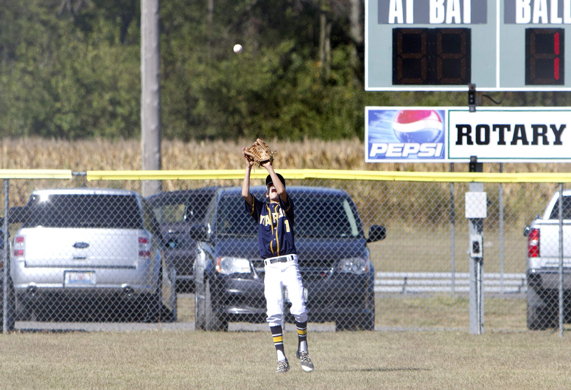 Walker Fox makes a catch in left field.