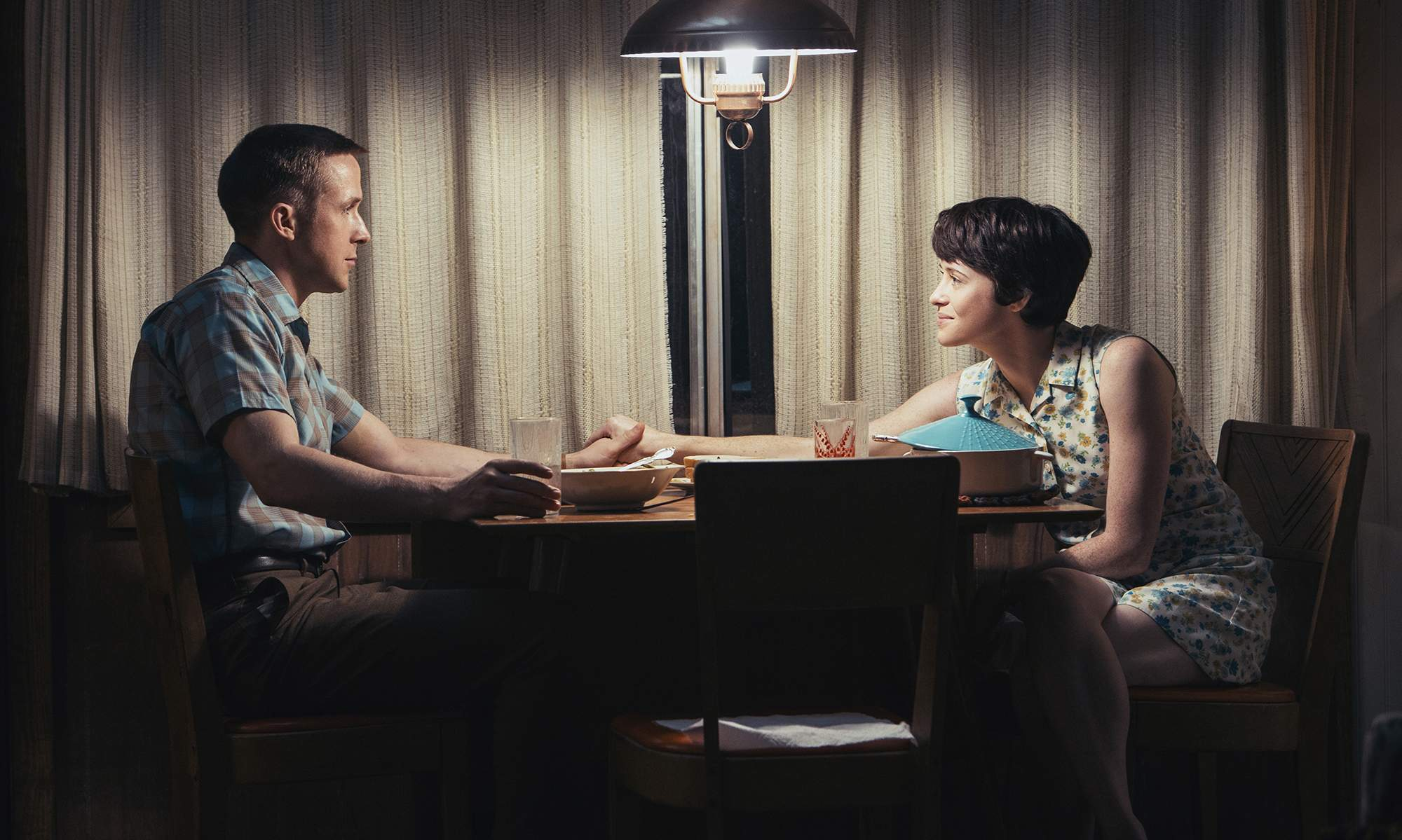 Neil Armstrong (Ryan Gosling) and wife Janet (Claire Foy) spend some alone-time together in 'First Man.'