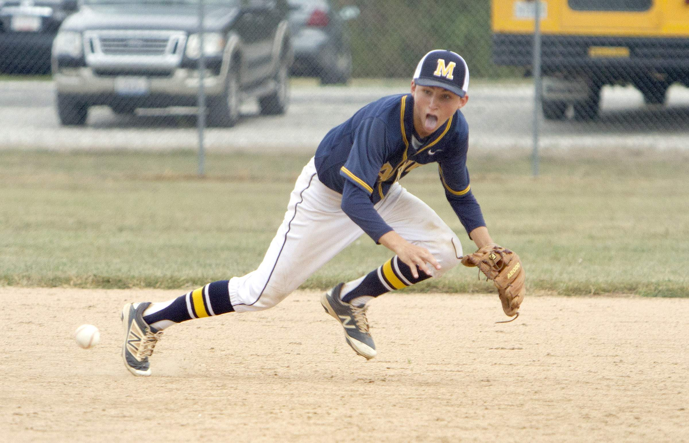 Mason Gooch dives for a grounder.