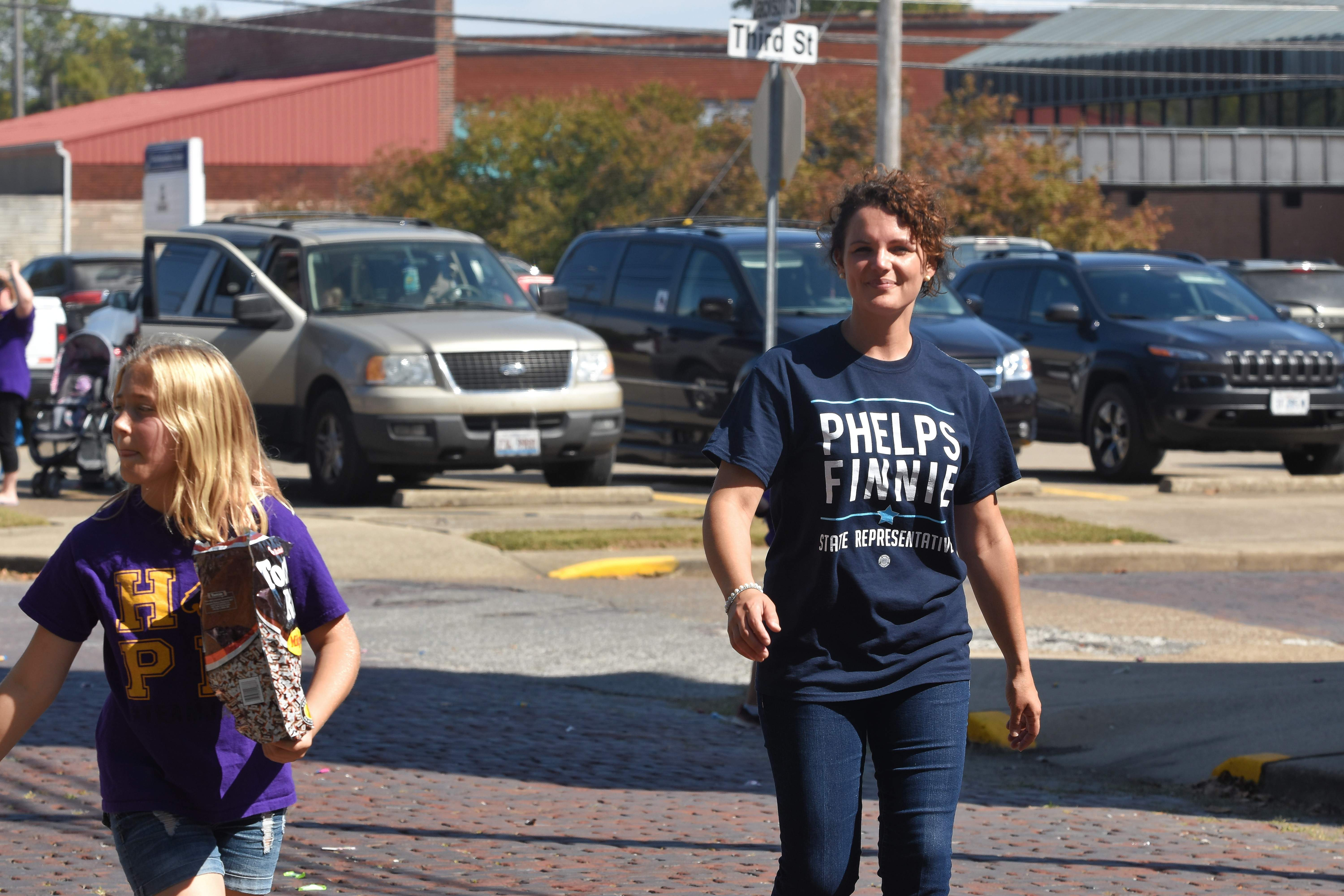 State Rep. Natalie Phelps-Finnie marches in the EHS homecoming parade.