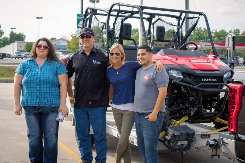 From left, Holly Krupp, owner and CEO of Roll N' Up Smoke Shop and Liquor; Outlaw Motorsports owner Matthew Rice of Harrisburg; winner Jacquie Glasco of Herrin and Jose Arredondo of Marion, A Roll N' Up employee, Jose convinced Jacquie to enter the sweepstakes.