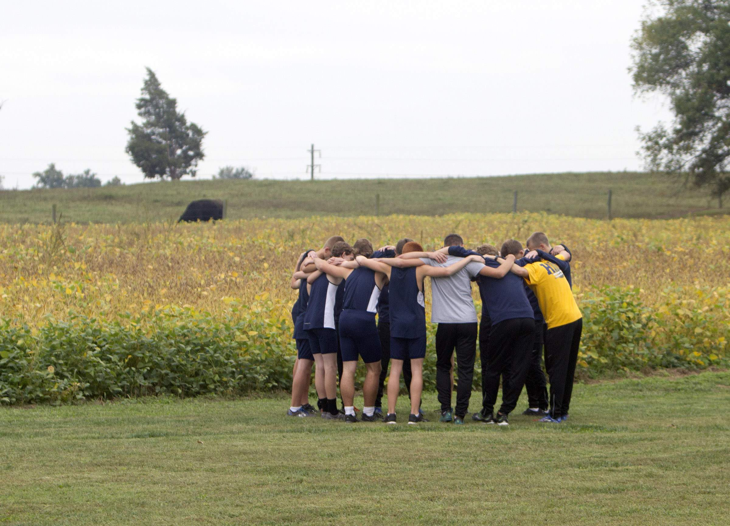 Boys huddle before race.