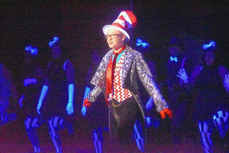 """Harrisburg High School student Carter Reed portrays the Cat in the Hat during a rehearsal of """"Seussical"""" Wednesday night at Southeastern Illinois College. The musical, based on the works of Dr. Seuss, was presented Sunday afternoon at the George T. Dennis Visual and Performing Arts Center."""