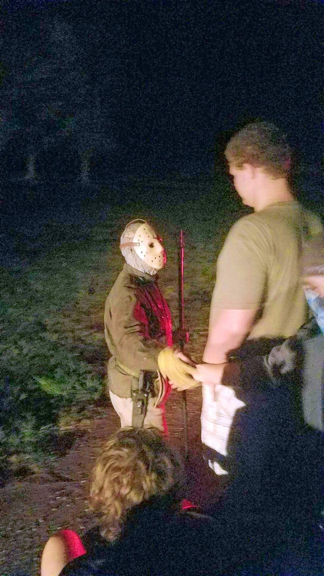 """""""Jason"""" shakes Patrick Krahel's hand while getting stared down by Blake Eversmann, at the Coleman Tri-County Services haunted forest over the past weekend. The actor C.J. Graham, who portrayed Jason Voorhees in the sixth installment of the """"Friday the 13th"""" movie series reprised his famous role for what is the 25th year of the haunted forest."""