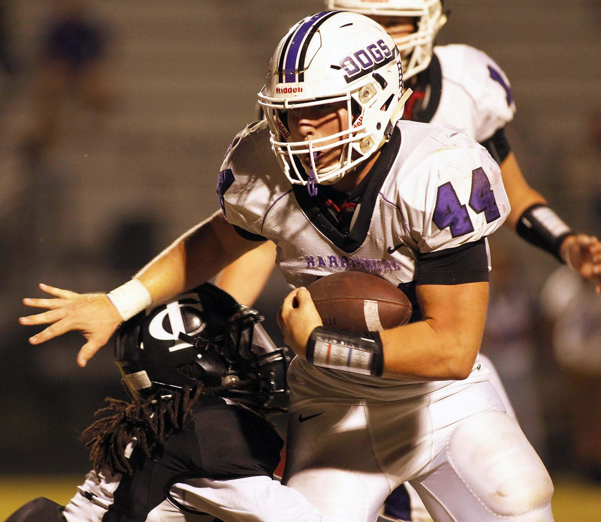 Harrisburg's Jordan Bartok scored three touchdowns in the Bulldogs' 32-22 loss at Carbondale Friday night.