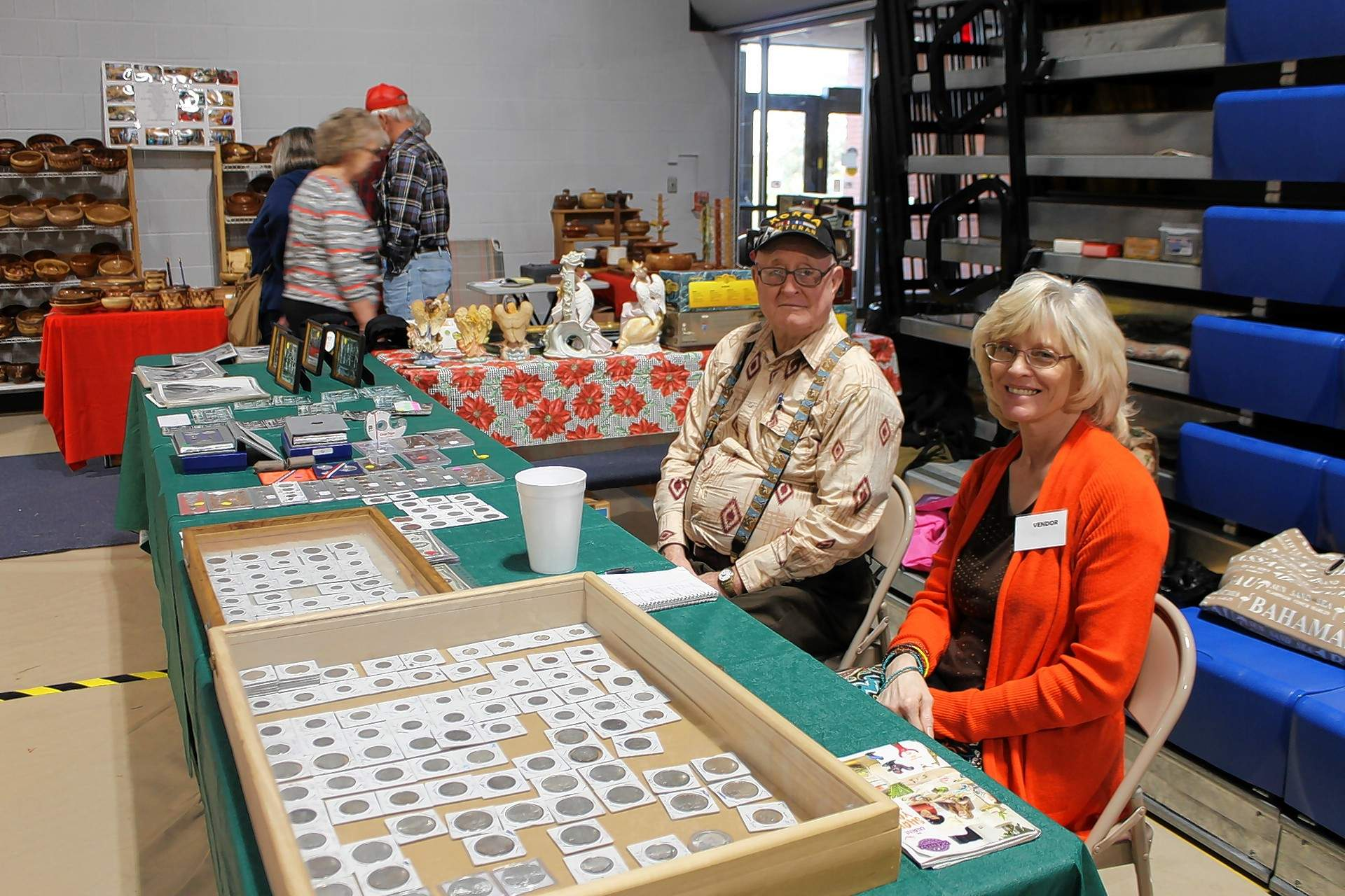 Ralph Harriman of Eldorado and daughter Peggy McDowell sell coins and collectibles during last year's Heritage Festival.