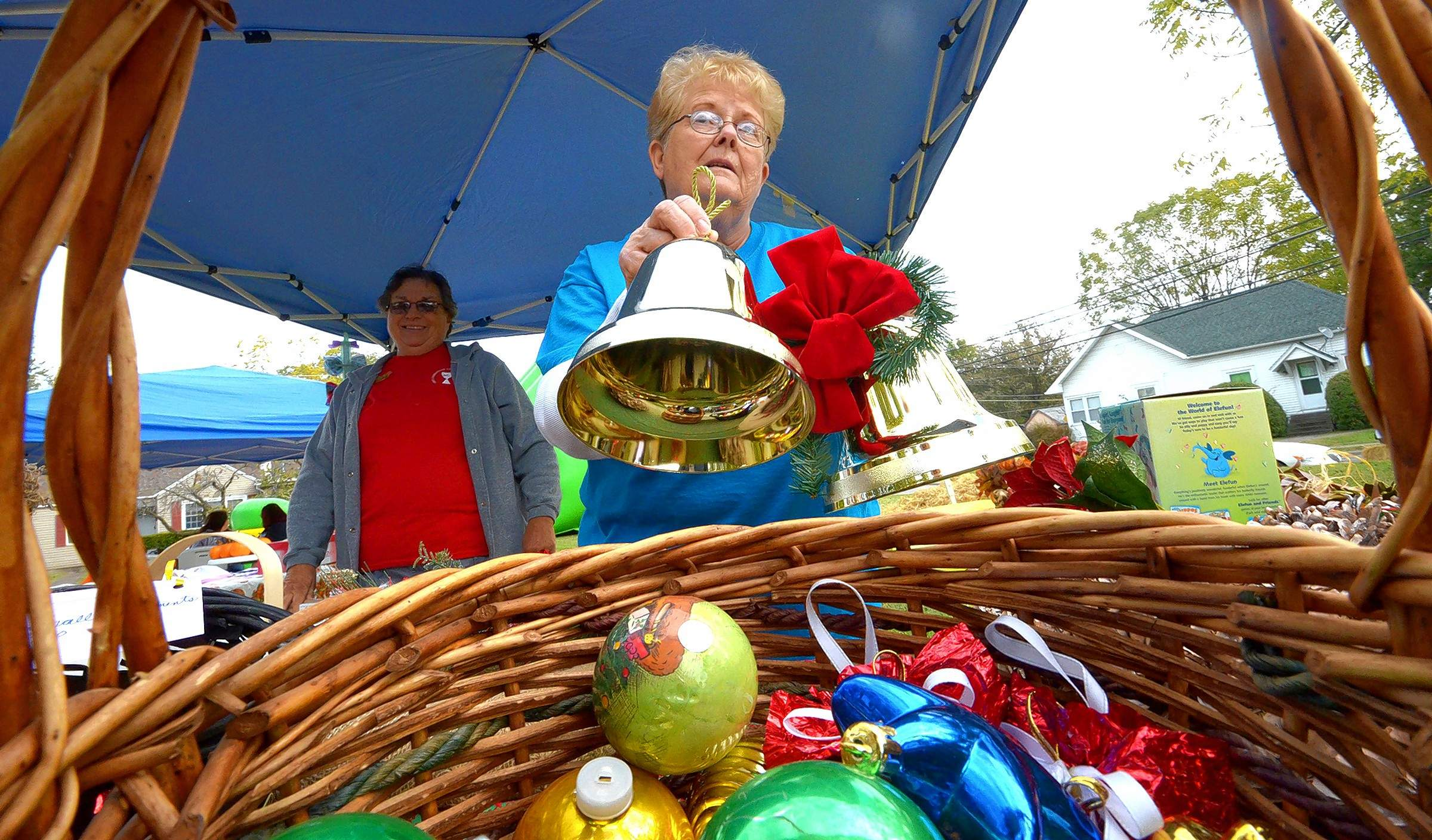 Cathy Summers sells bells and ornaments at the booth she oversaw at this year's Fall Harvest.