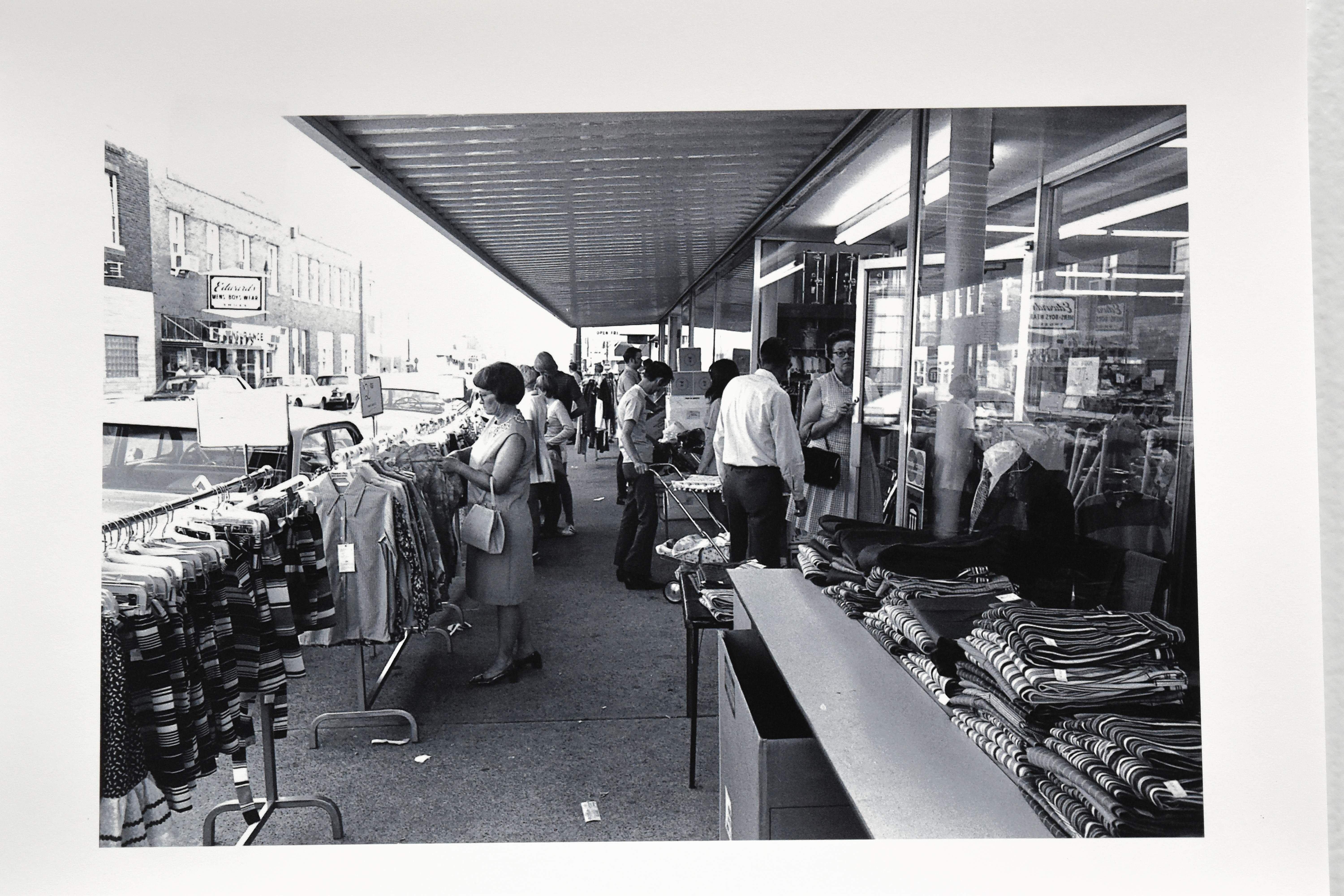 An image of a sidewalk sale in front of the Eldorado Ben Franklin in 1971 taken by Charles Hammond.