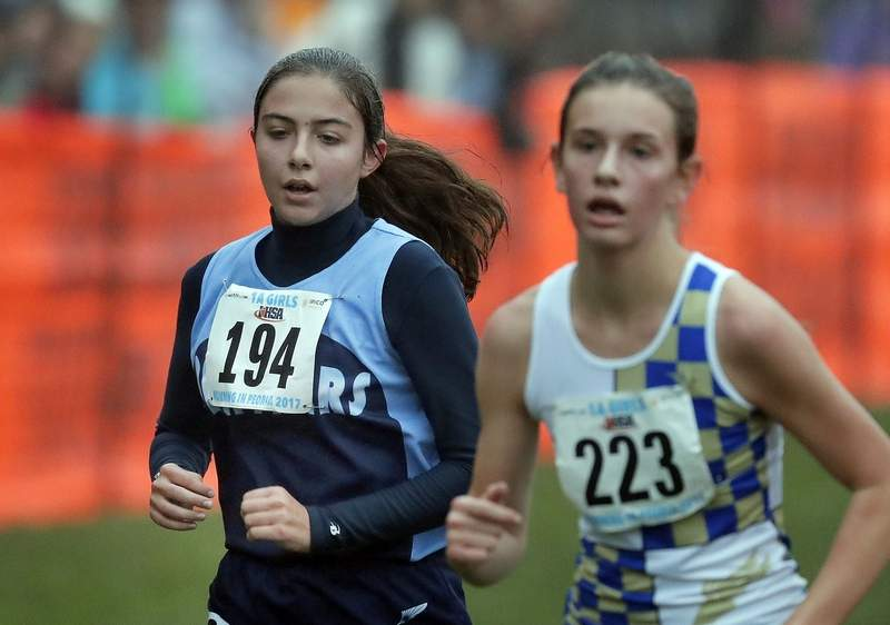 Pinckneyville's Olivia Buza runs in the girls Class 1A cross-country finals Saturday in Peoria.