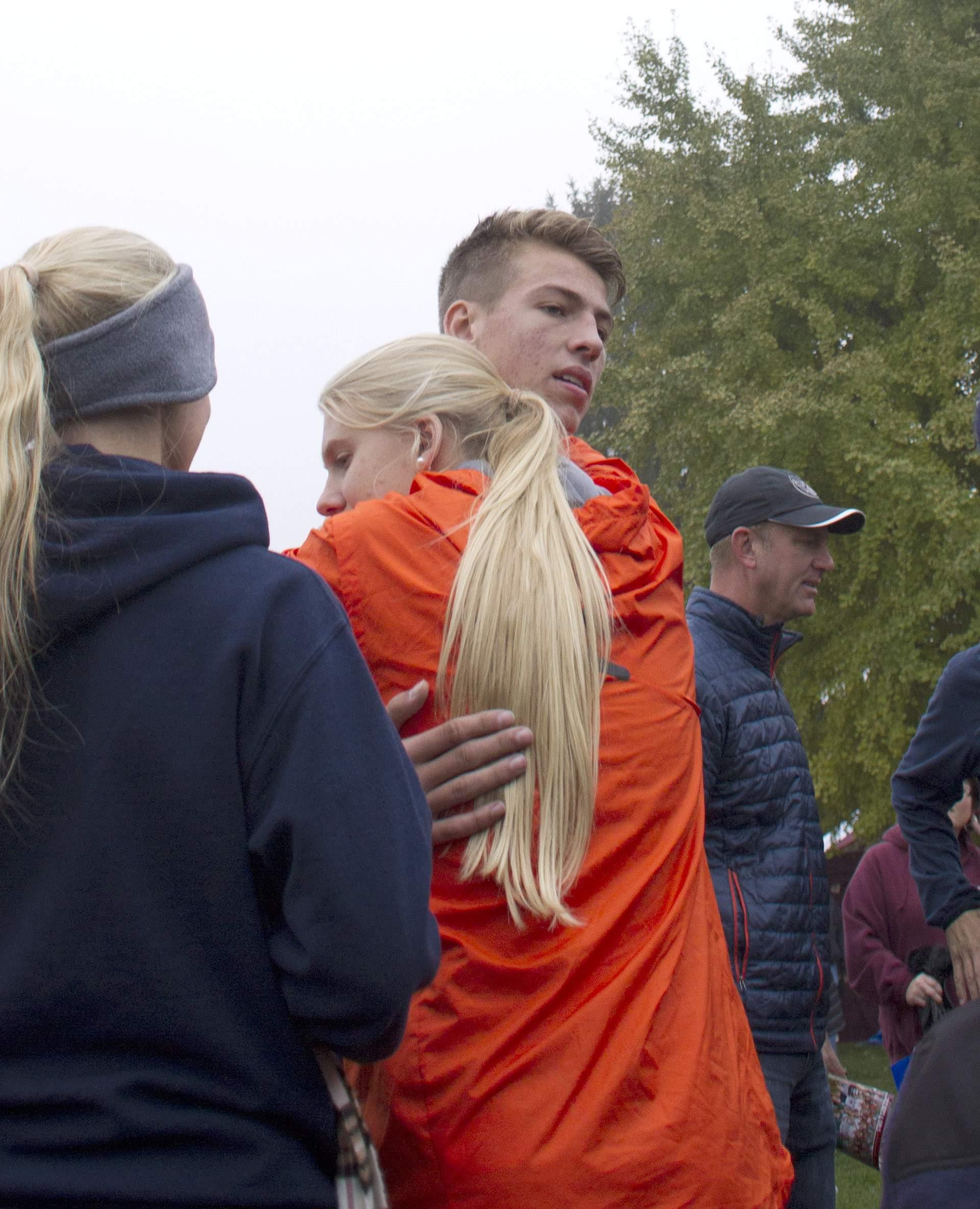 John Bruce gets a hug from sister Madeline.