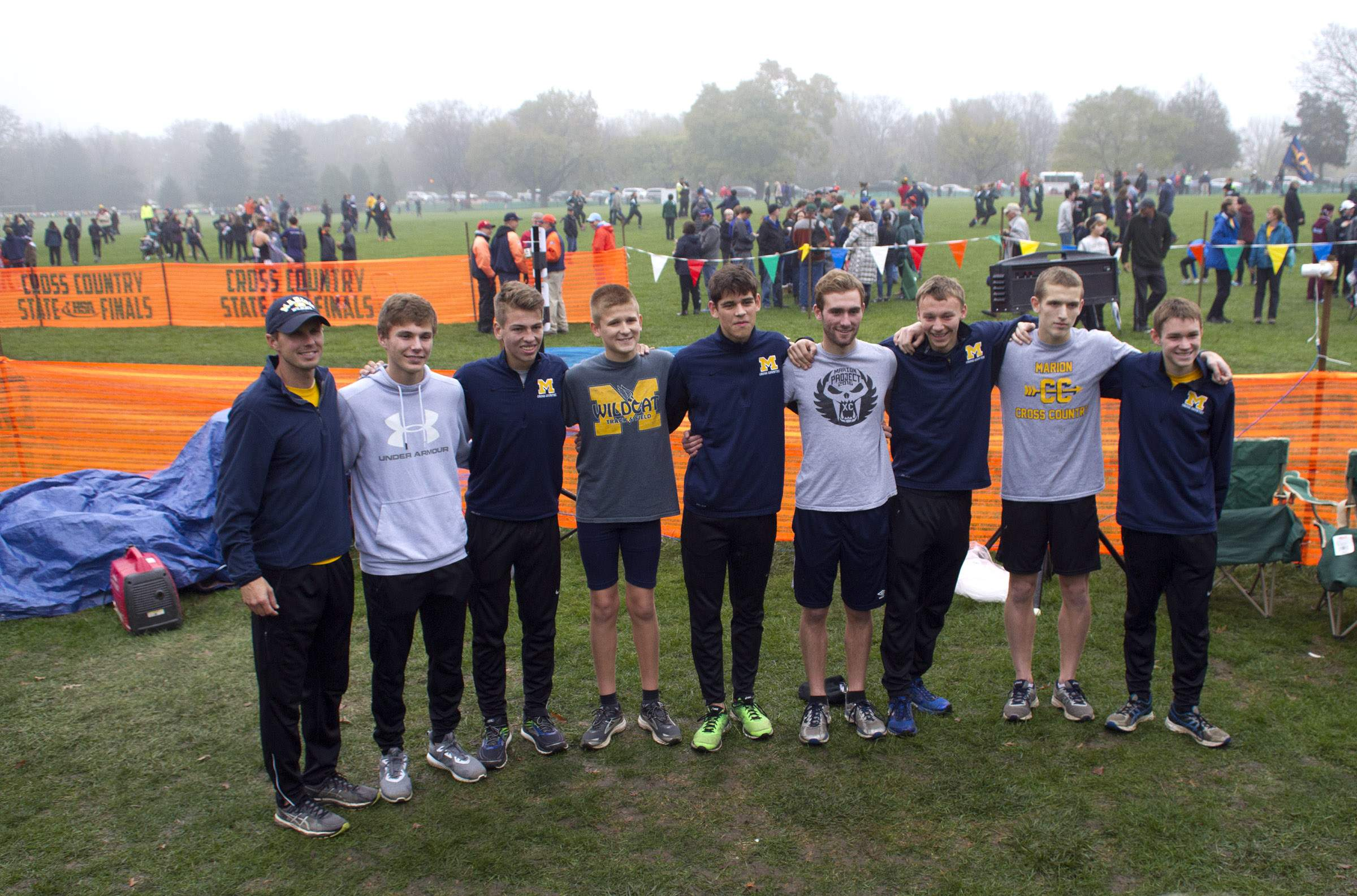 Marion's runners pose with coach Eli Baker.