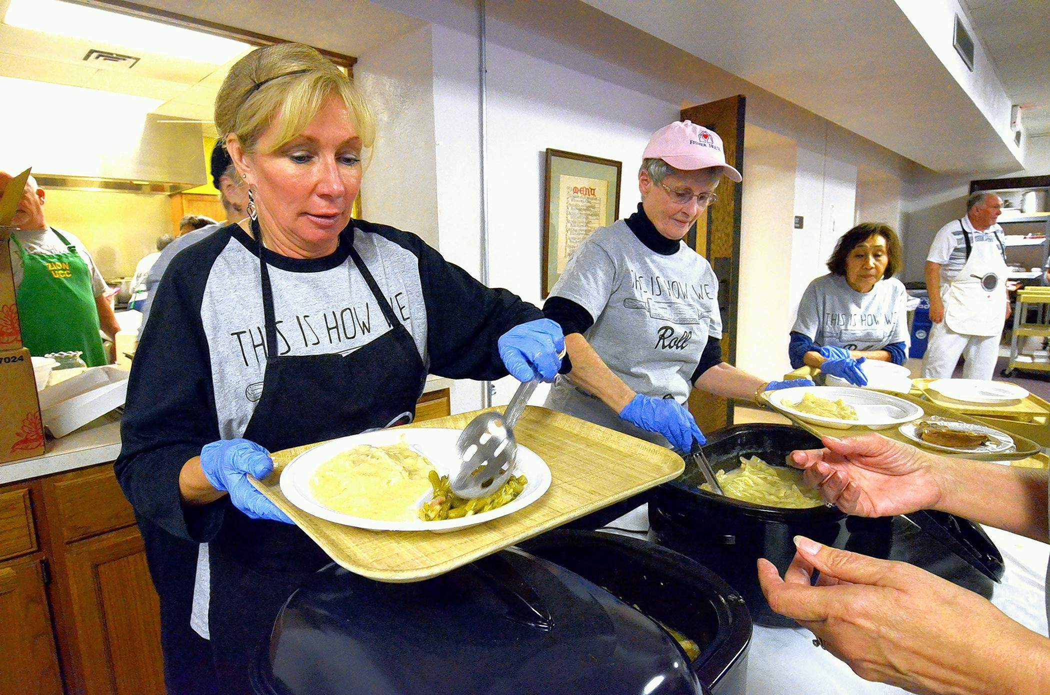 Rose Wentland, left, and Sharon Wilson were busy serving up chicken and dumplings and green beans at the Zion United Church of Christ's annual Chicken and Dumpling Dinner Friday in Marion.