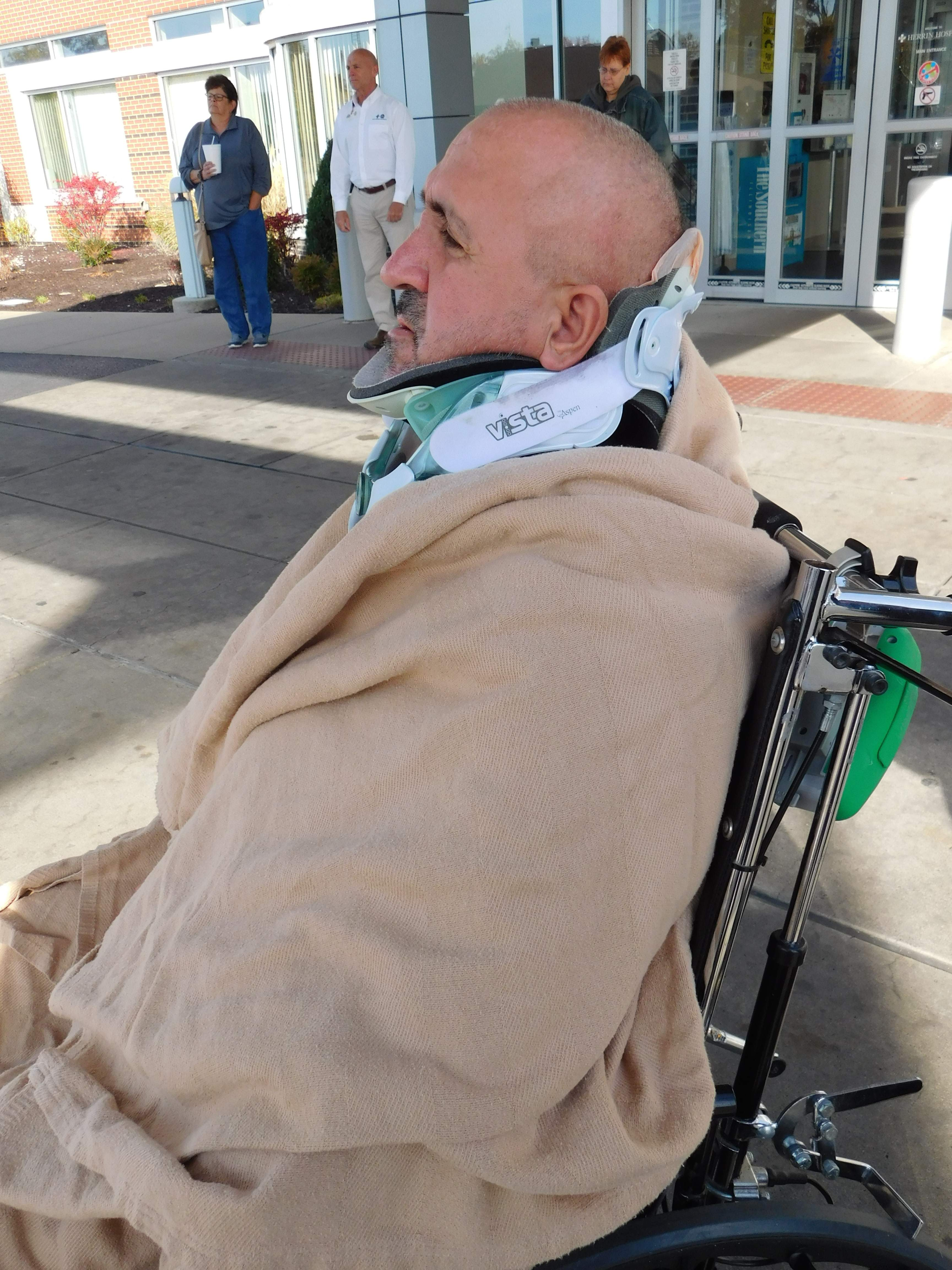 Herrin Hospital patient Garry Kelley left his bed to brave the cold temperatures to attend the annual Veterans' Day ceremony Friday morning.  Kelley, a veteran of the U.S. Marine Corps, has been a patient since an accident on Sept. 20.