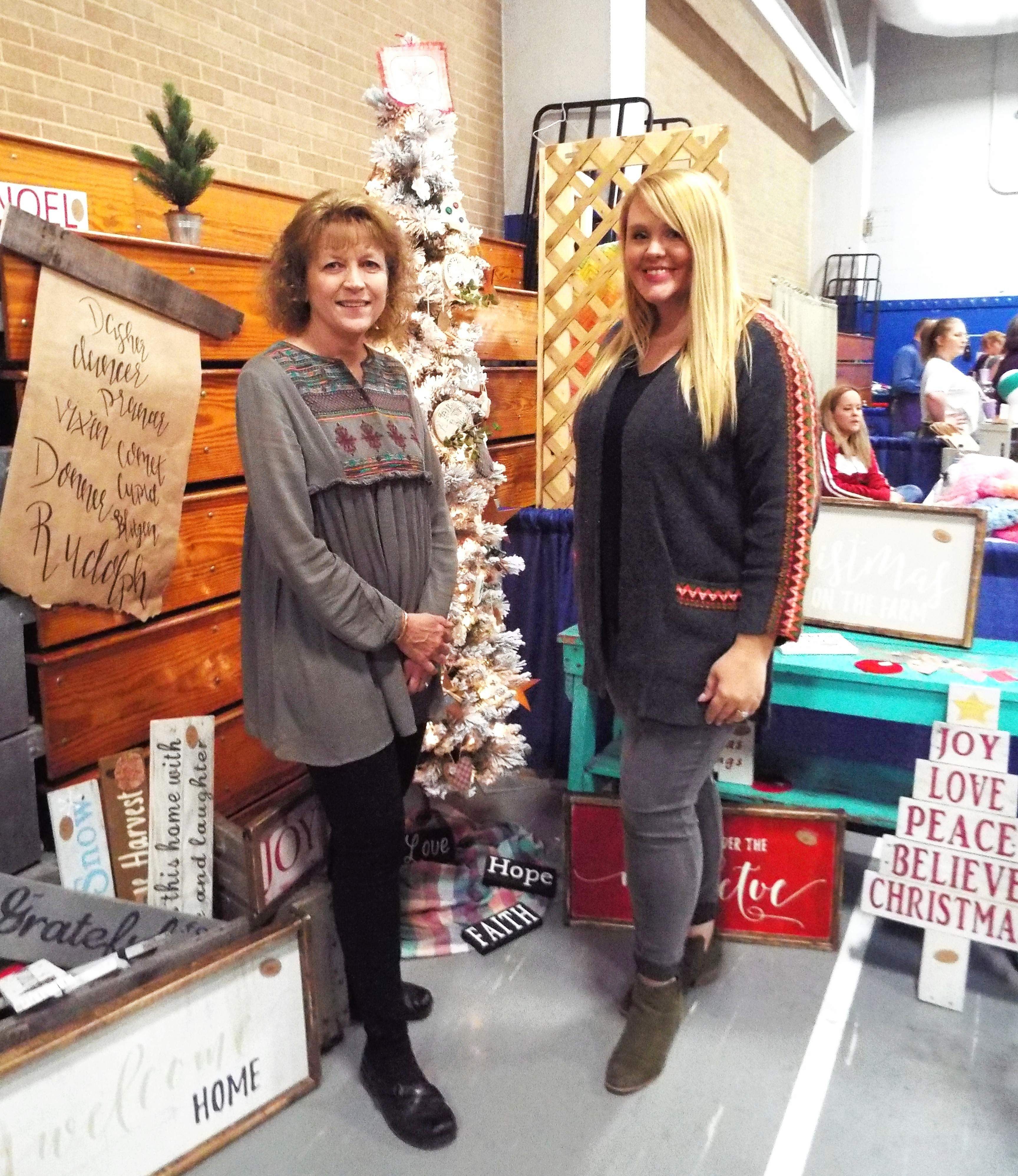 Teresa, left, and Amanda Pauls stand ready for shoppers at John A. Logan's annual arts and crafts extravaganza.