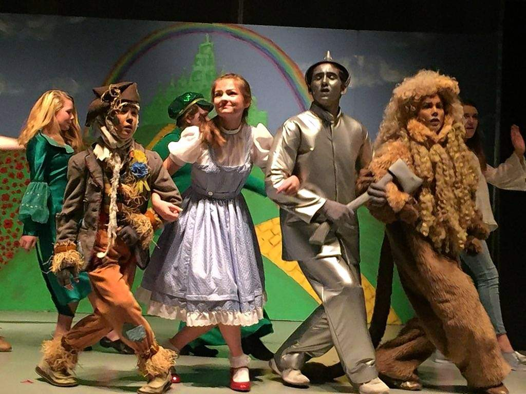 Cast members of Harrisburg Middle School's 'The Wizard of Oz' make their way down the Yellow Brick Road in this rehearsal photo. The musical is 7 p.m. and 2 p.m. Sunday at Harrisburg Middle School.