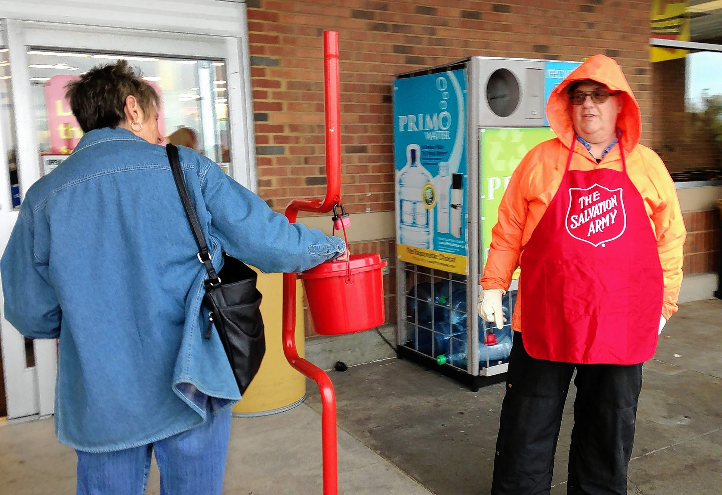 "This was the scene this week at the entrance to the Kroger grocery store in Marion where bell ringer Robert Bazzetti was accepting contributions. The Marion man said this was his first day and first year as a bell ringer. ""It hasn't been too bad so far, although the air was a little crisp when I started this morning!"" he said."