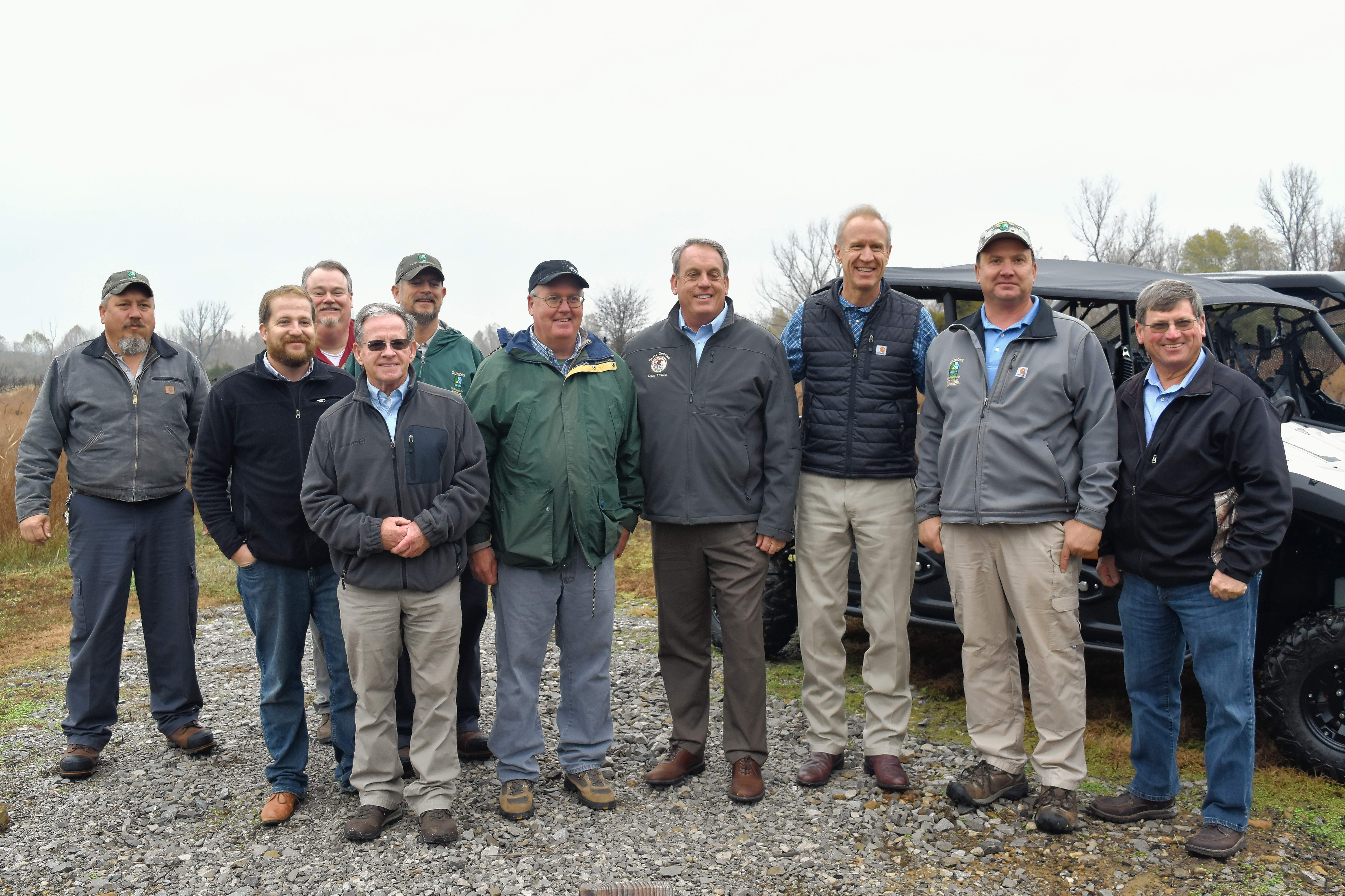 Illinois Department of Natural Resources employees stand for a photo with Gov. Bruce Rauner and IDNR Director Wayne Rosenthal.