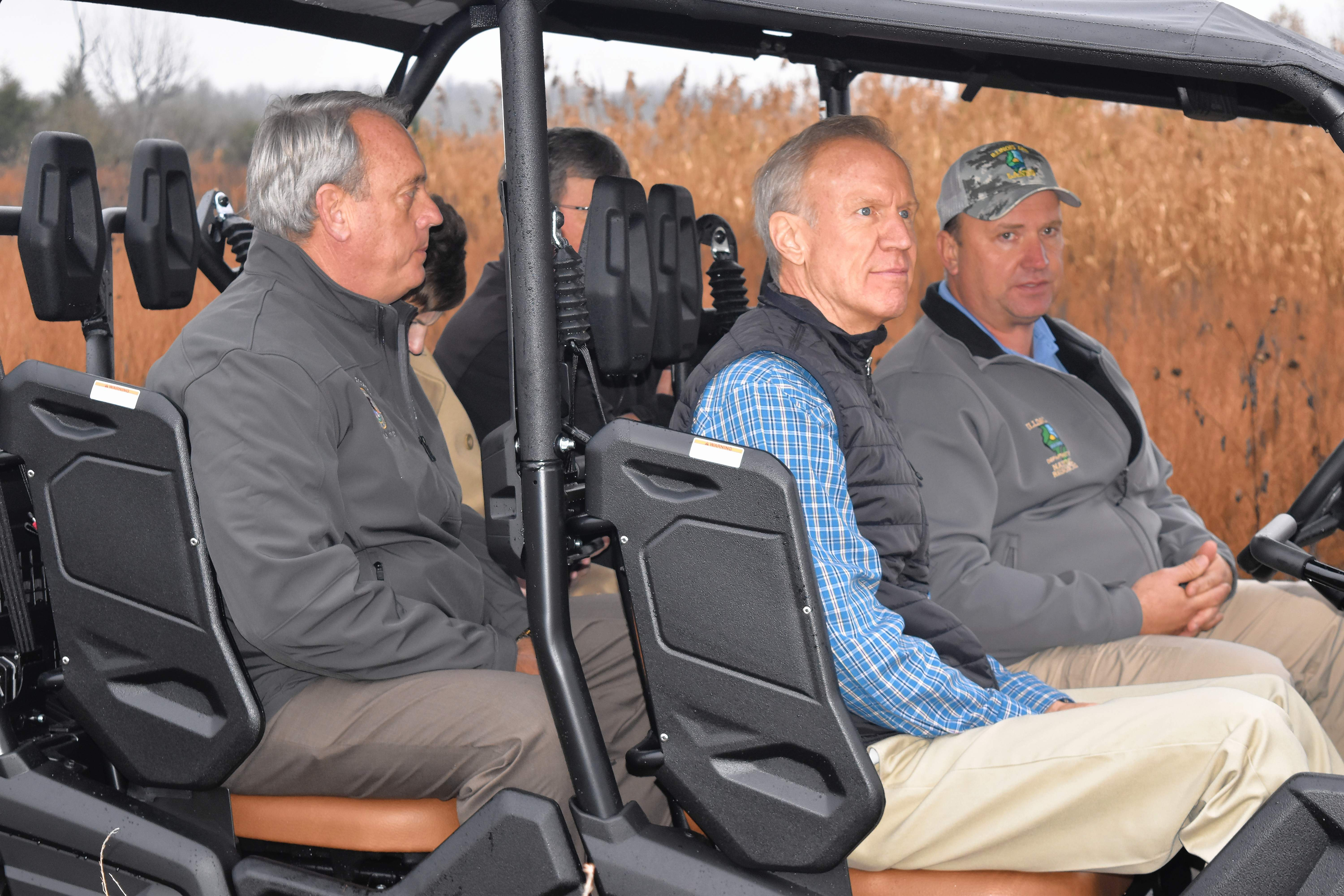 Sahara Woods Site Superintendent Eric McClusky, right, talks with Gov. Bruce Rauner Wednesday afternoon on a quick drive at the site of a future off-highway vehicle park. State Sen. Dale Fowler, R-Harrisburg, and Illinois Department of Natural Resources Director Wayne Rosenthal also were in the vehicle.