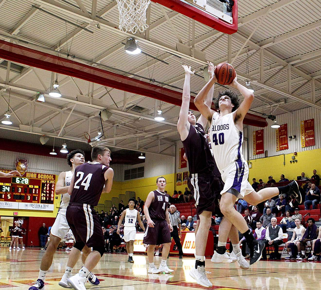 Harrisburg senior forward Dalton Lambert (40) had 15 points and 12 rebounds for the Bulldogs in a 48-26 win over Red Bud at the Ernie Bozarth Memorial Tournament Wednesday night. It's the third straight double-double for Lambert.