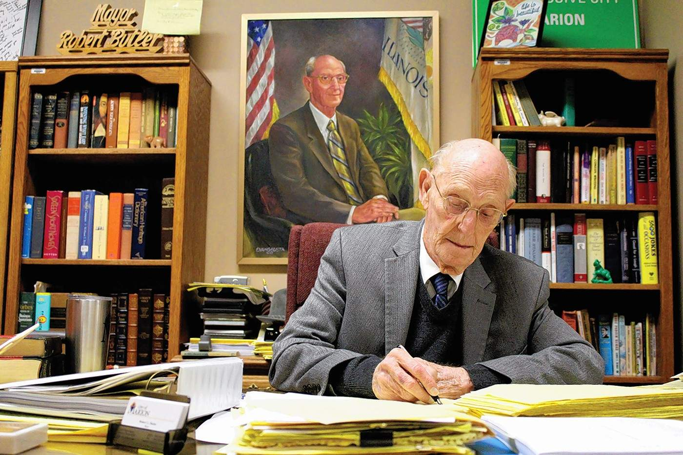 """Marion Mayor Robert """"Bob"""" Butler signs a city proclamation. Butler is one of the longest-serving mayors in U.S. hstory, in office since 1963."""