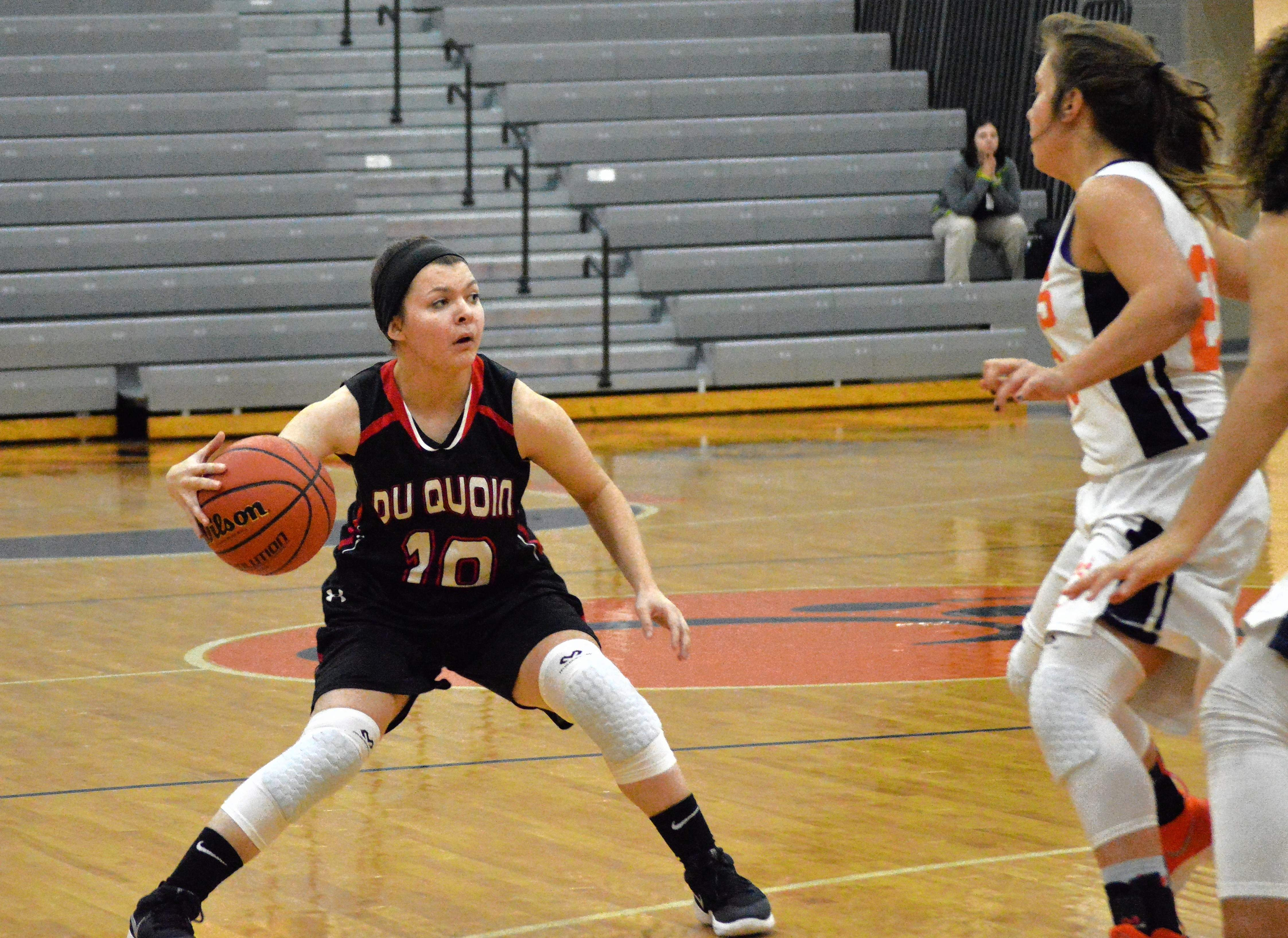 Katie Smith maneuvers the ball away from Lions' defenders.