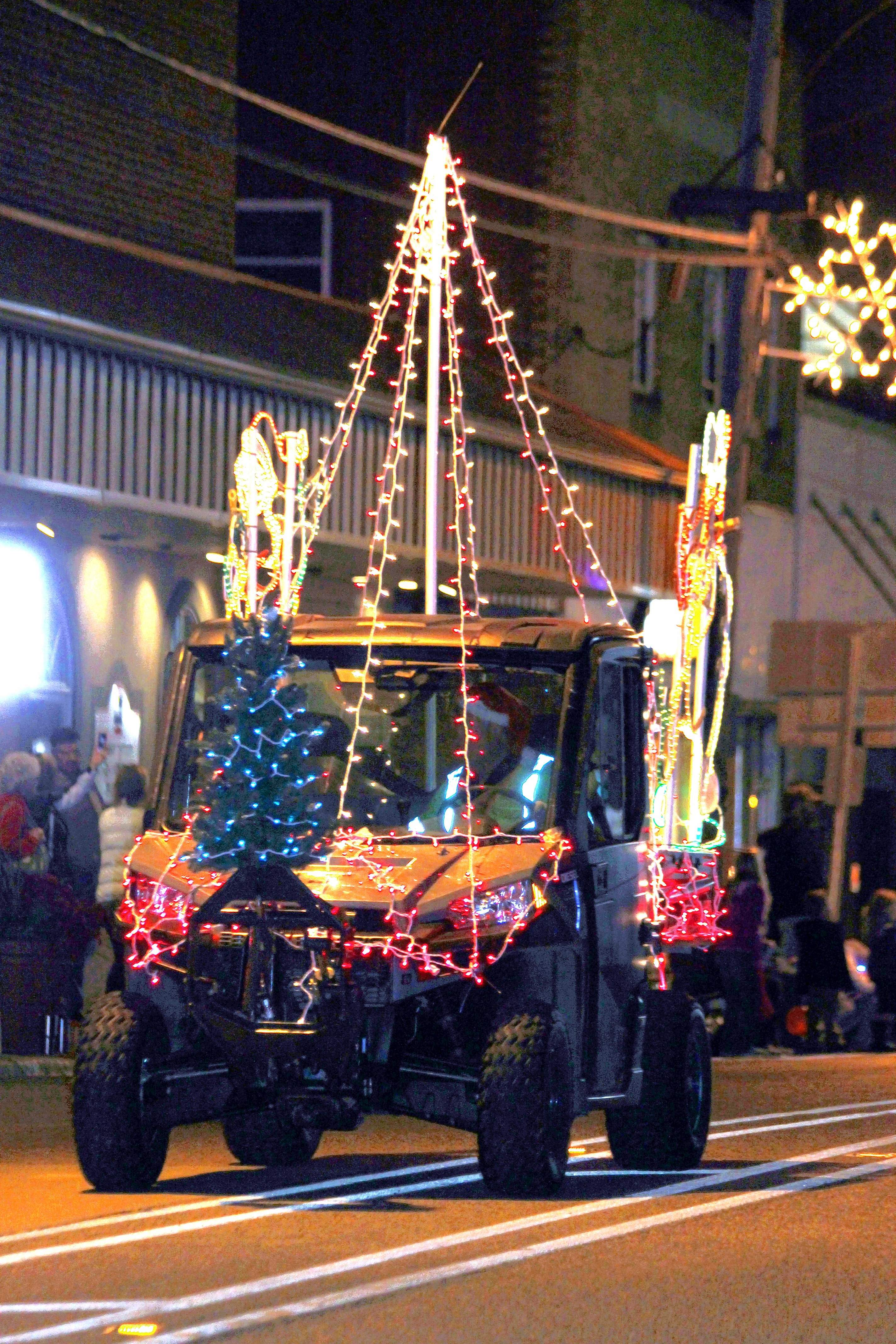 The parade did not have a specific theme this year, allowing for a variety of entries with lighted displays.