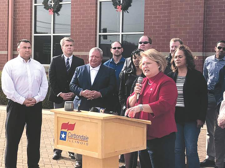 State Rep. Terri Bryant, with Carbondale Mayor Mike Henry and other Carbondale officials, host a flag-raising ceremony for Illinois' bicentennial celebration.