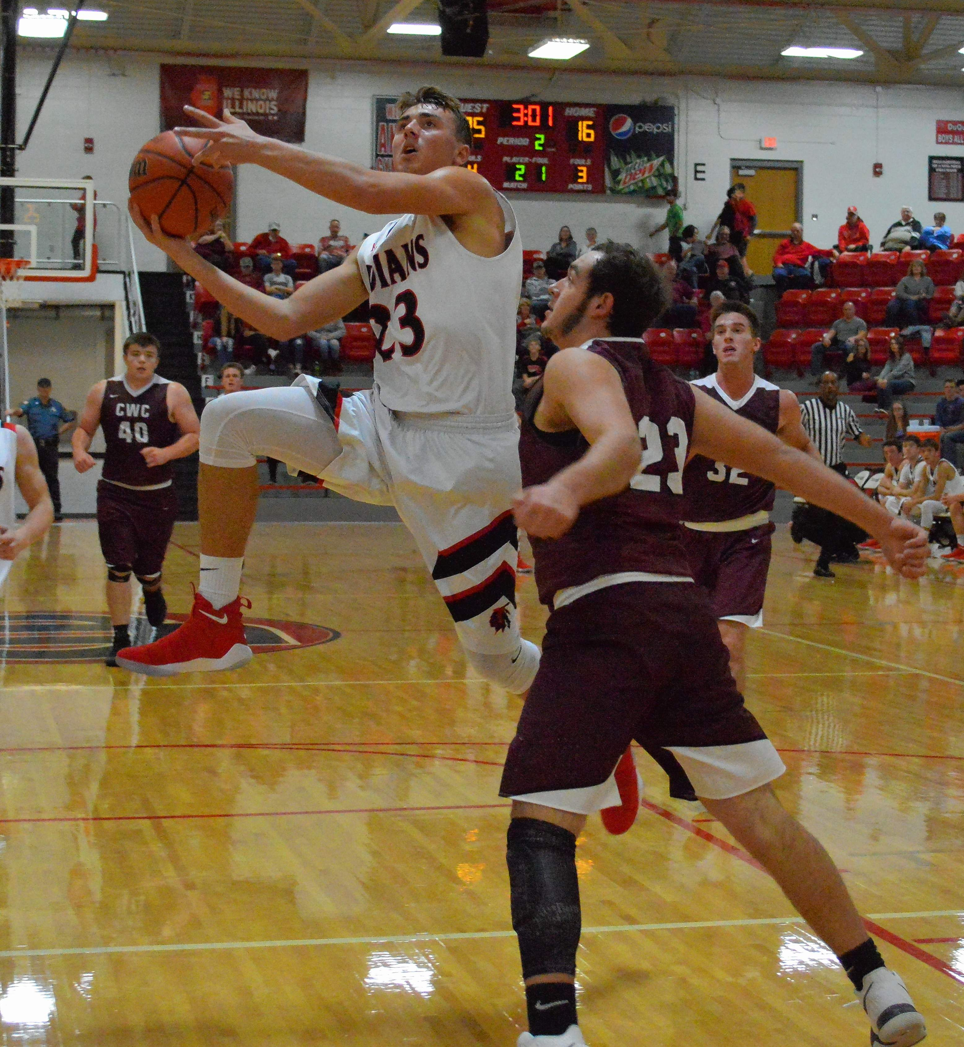 Indians' Braeden Pursell goes up for a layup Saturday night during his team's win over the Carmi-White County Bulldogs.
