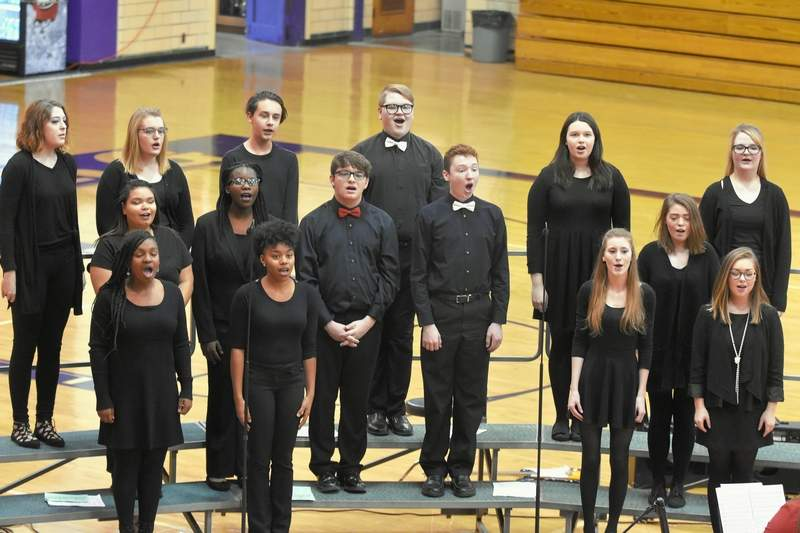 Harrisburg High School's Concert Choir sings during the Christmas concert Sunday at Davenport Gym in Harrisburg.
