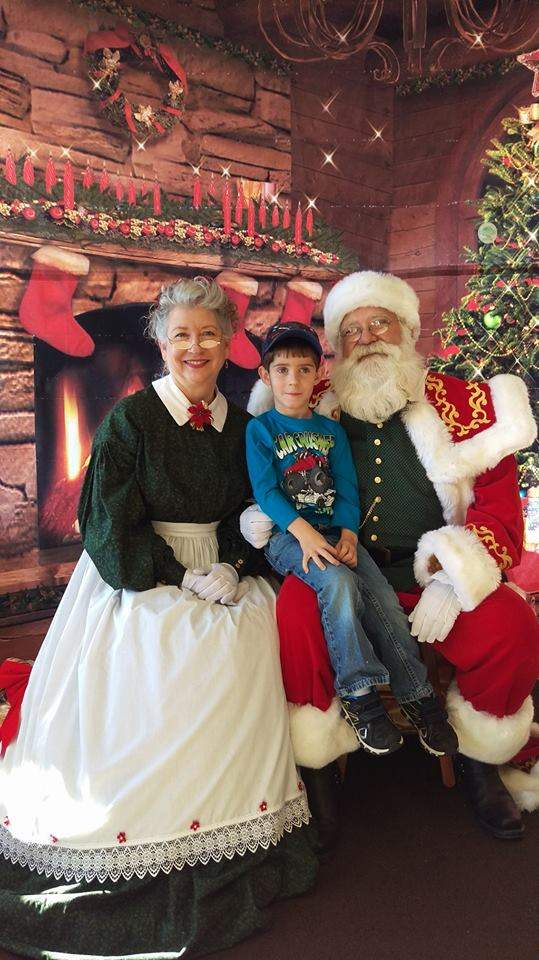 Pictured is 4-year-old Gunner Hartman, of Perryville, with Santa Claus and Mrs. Claus in a recent photo.