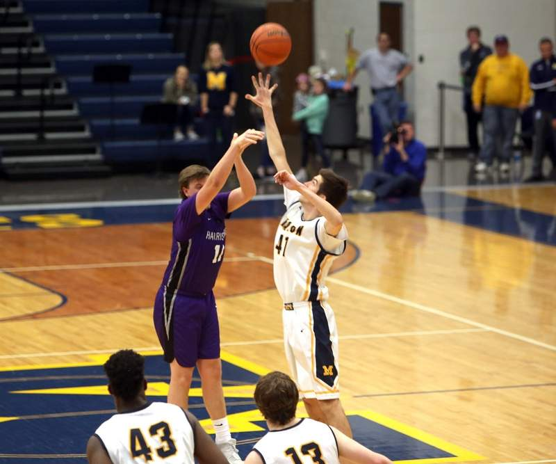 Carson Burtis shoots over Cole Schafer for a 3-pointer that sent Saturday's game into overtime.