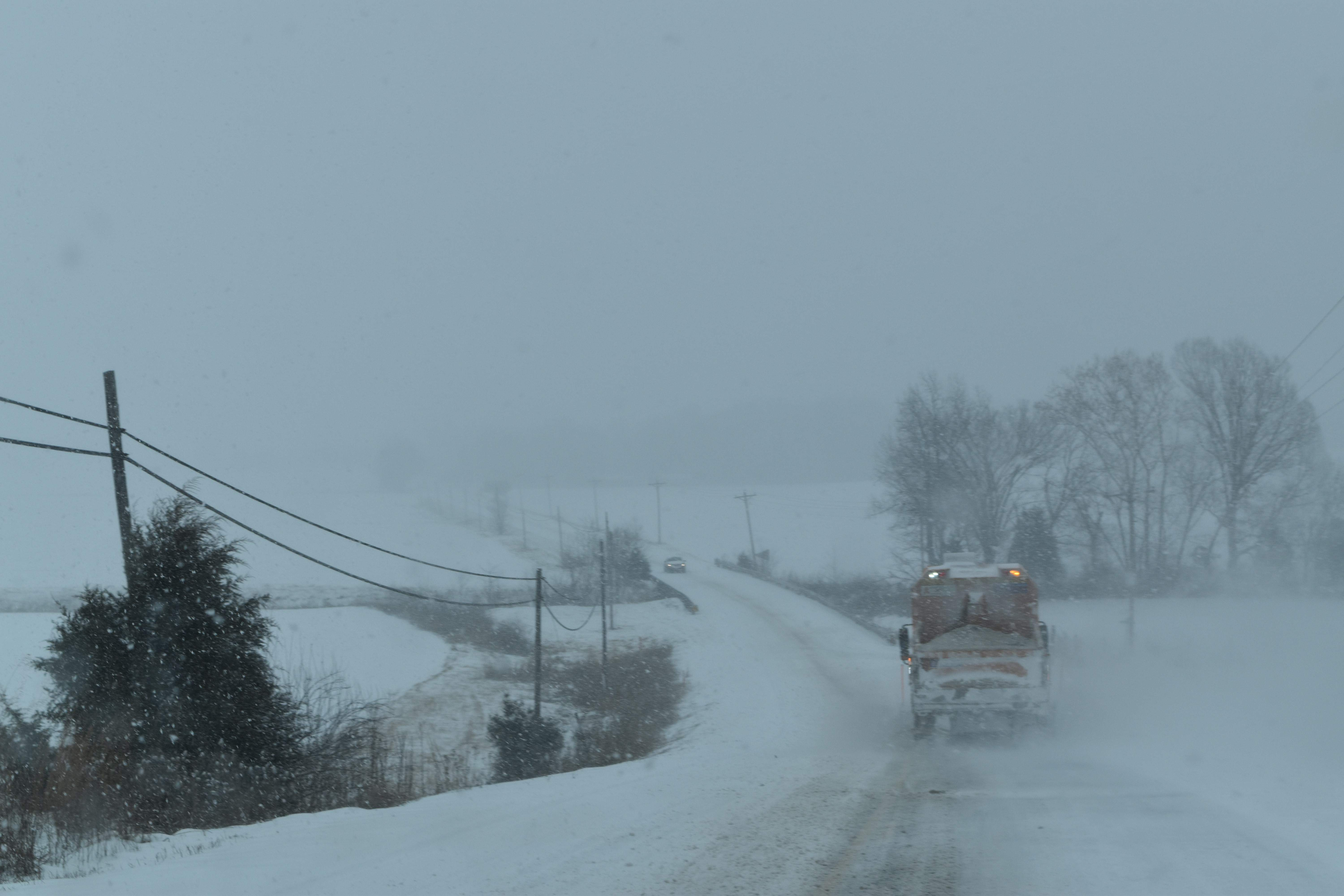 A lonely snowplow does its work on Illinois 34 south, near Illinois 145.