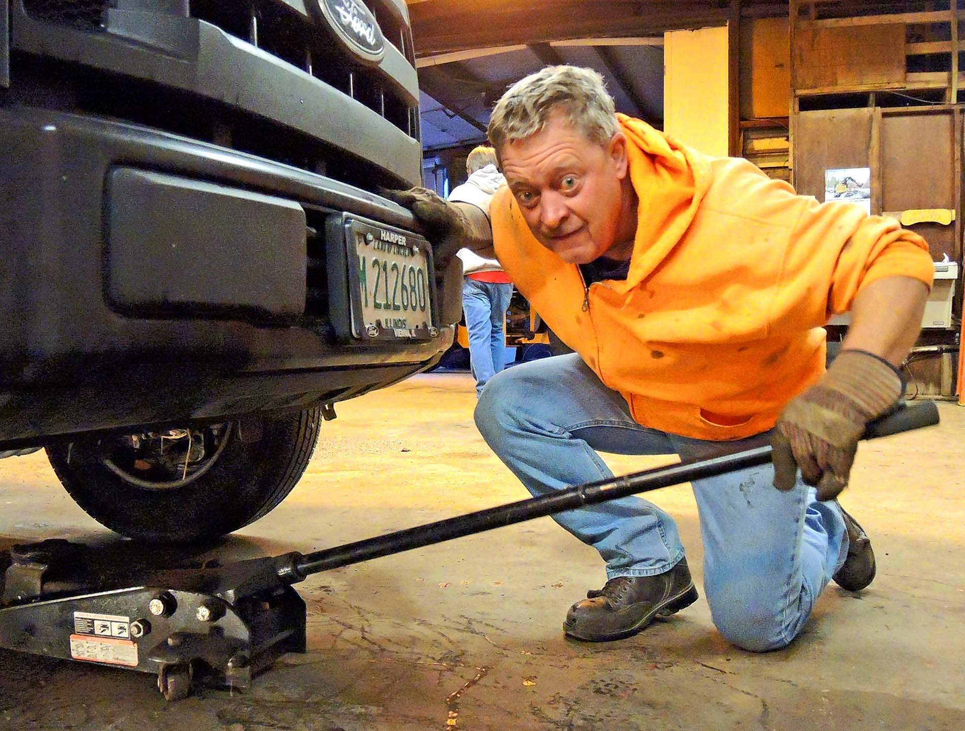 Senior maintenance worker Kenny Murphy prepares to change the oil in the foreman's pickup truck Thursday morning.