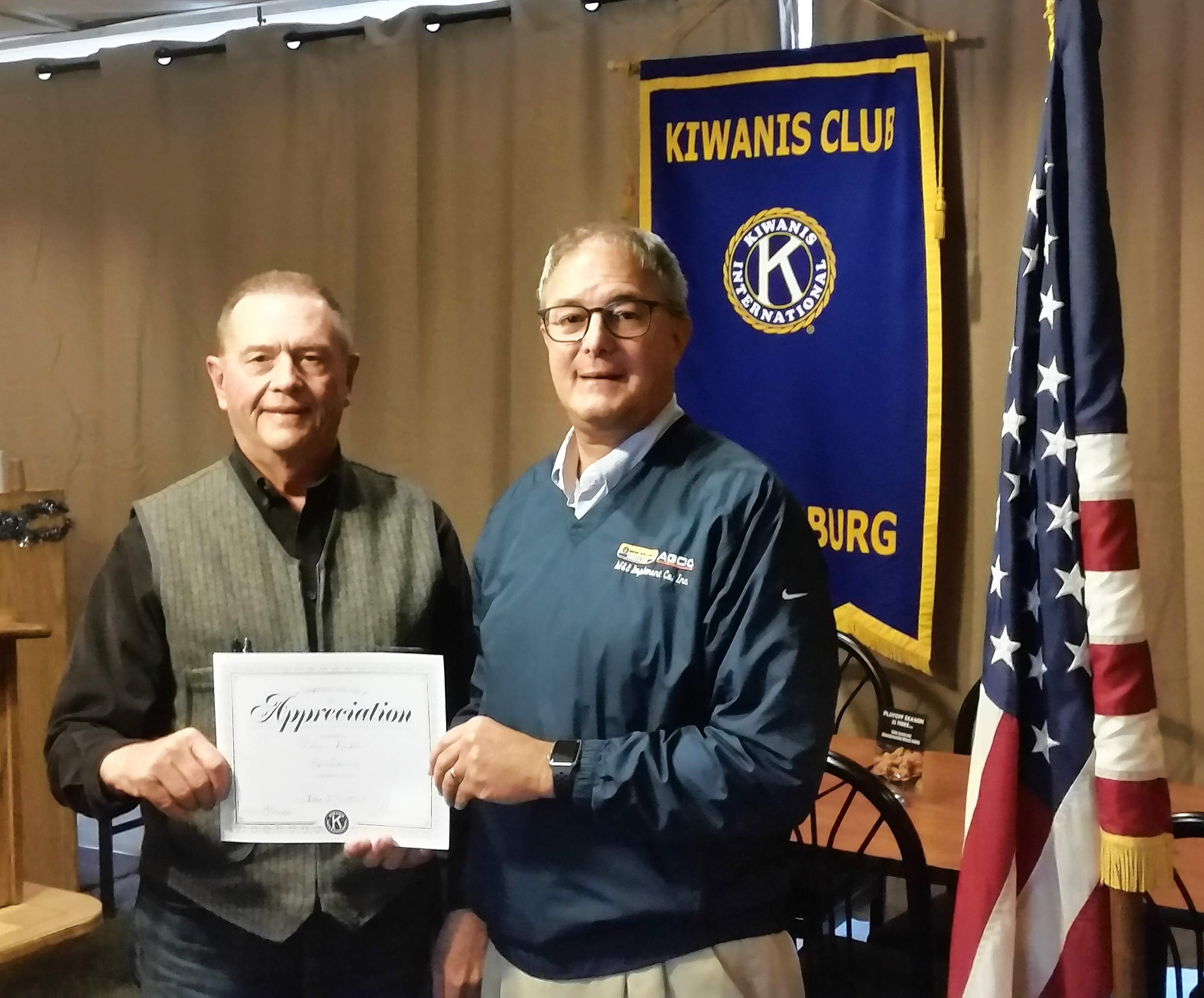 Roger Apple (right) accepts a certificate of appreciation from past Kiwanis Club President Tom Fleege for serving as guest speaker at the Dec. 27 meeting.