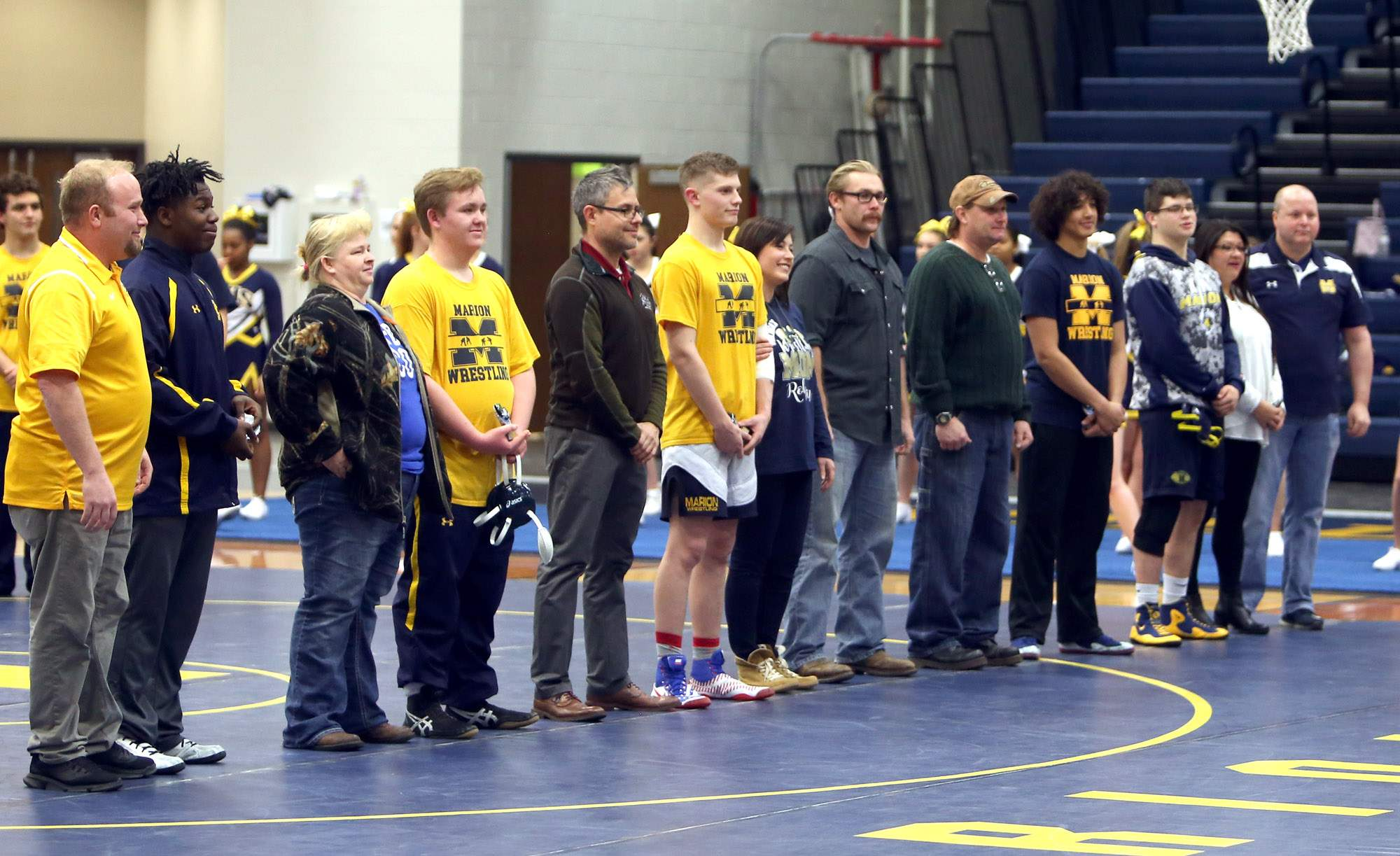 Marion seniors Kasolon King, JoeAbe Eroh, Rohan Cook, Michael Cerv and Michael Cantrell were honored prior to Tuesday's match.