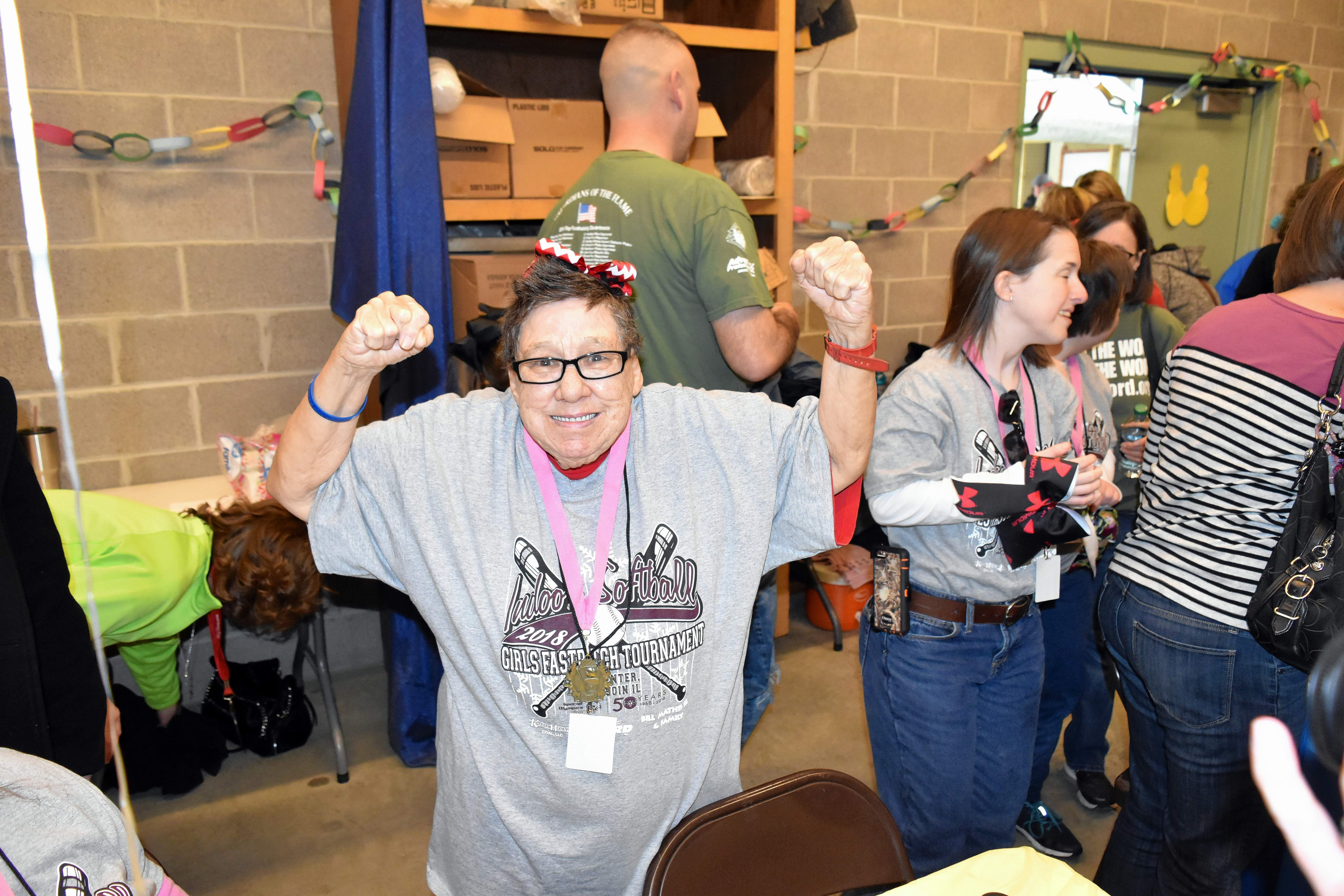 Special Olympics athlete Barbara Dillow poses for a photo during a complimentary meal prior to the opening ceremony.